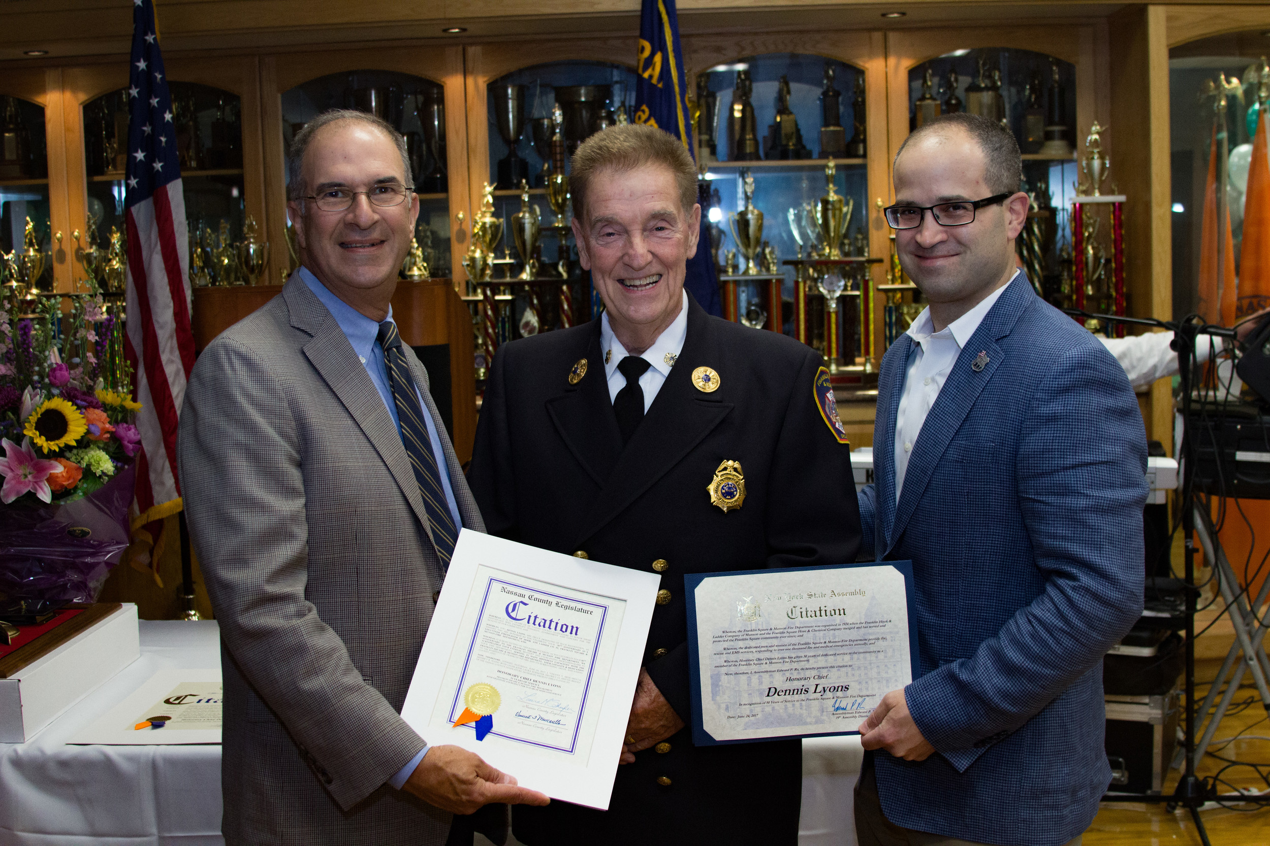 Franklin Square and Munson Fire Department Commissioner Dennis Lyons was honored for 50 years of service on June 24. From left are Nassau County Legislator Vincent Muscarella, Lyons, and Assemblyman Edward Ra, who represents Franklin Square.