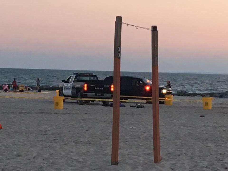 The officer was responding to an emergency call when his vehicle came in contact with two beachgoers, police said.