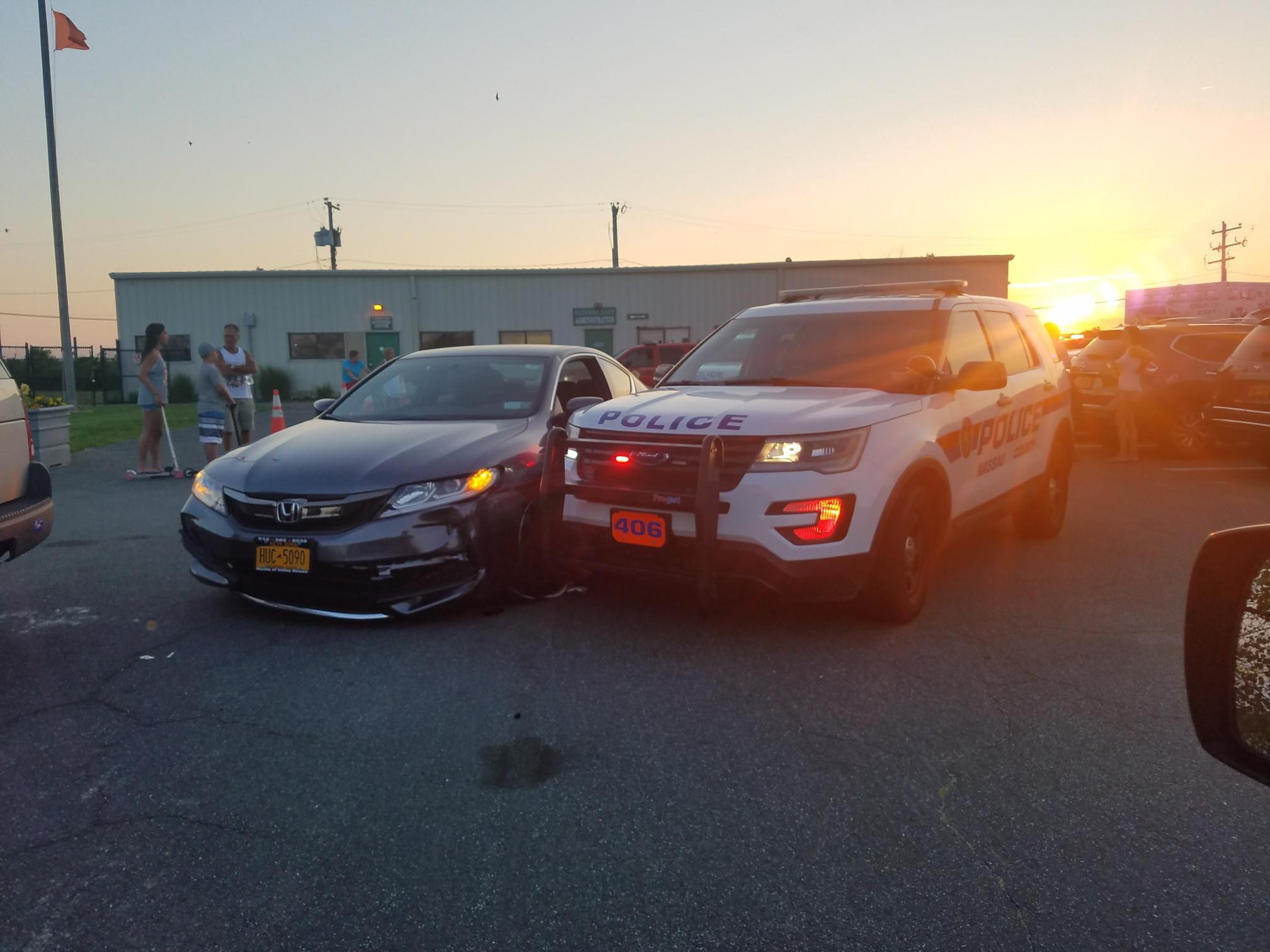 Nassau County Police arrested a Queens woman in Lido Beach on Sunday after she drove into a police cruiser and injured two officers.