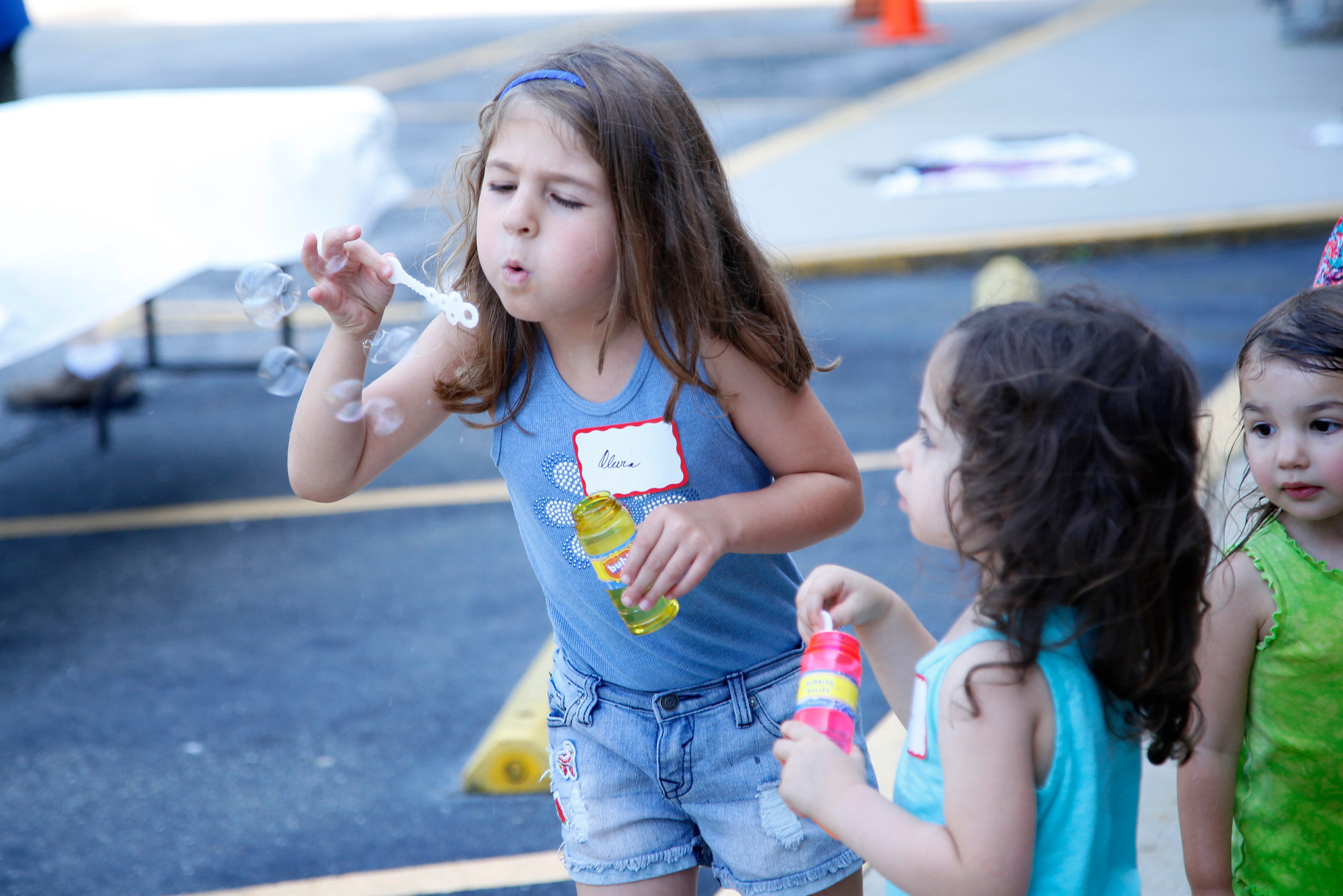 Four-year-old Olivia Torosian enjoyed the summer barbecue.