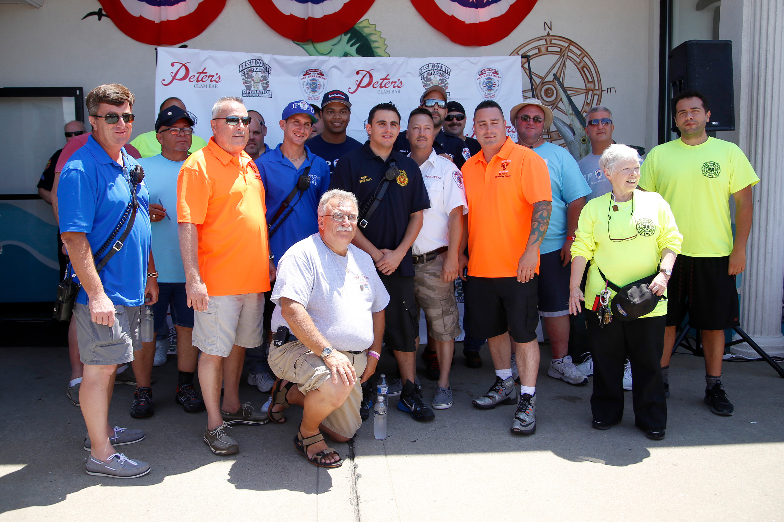 Members of the Island Park Fire Department stood outside Peter's Clam Bar for its Annual Long Island Clam Eating Contest.