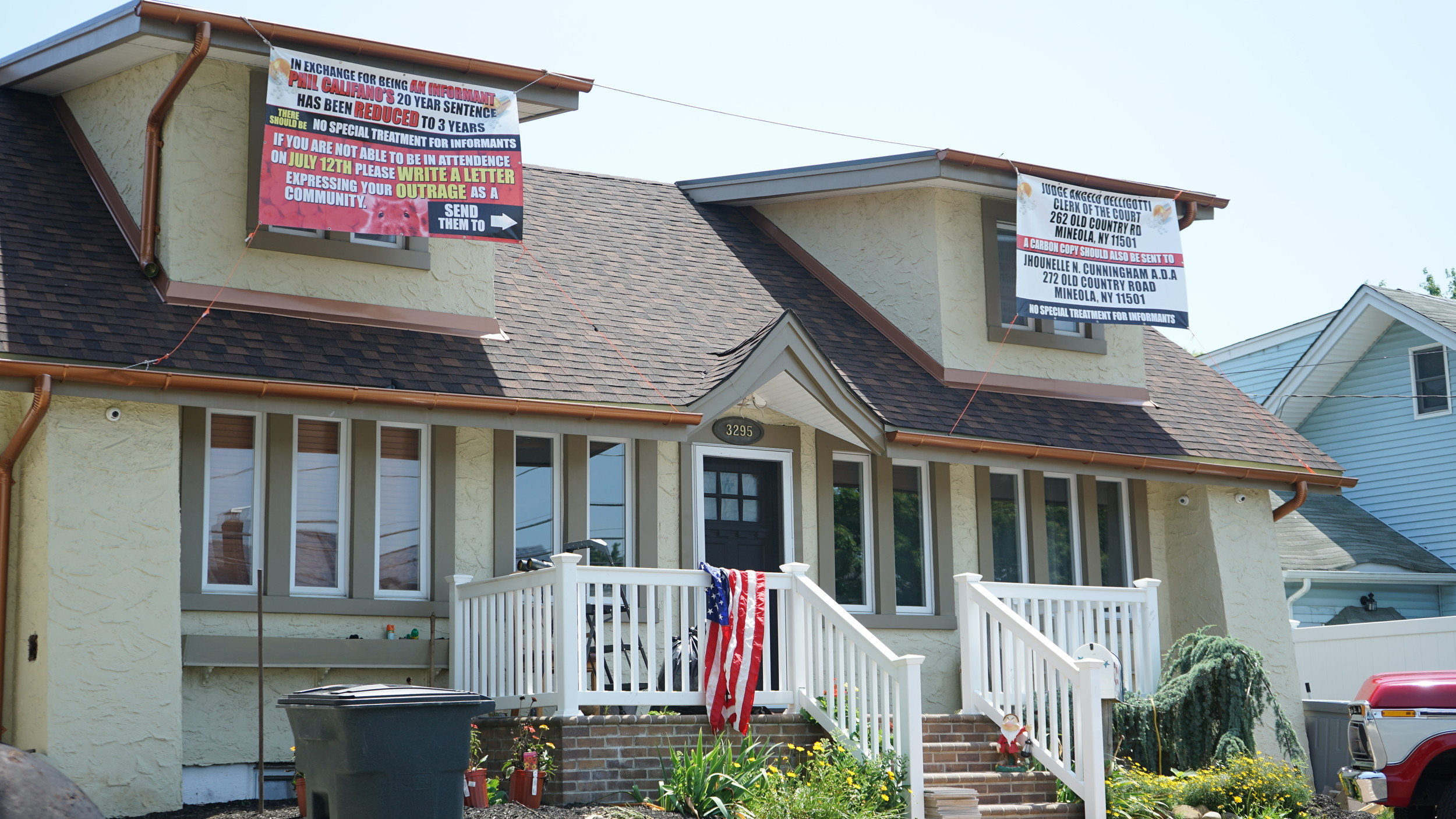 Banners hung outside of Dana Mahan's 4th Street home accusing alleged drug dealer and neighbor Filippo Califano of seeking a plea deal by becoming a confidential informant and imploring residents to protest the secretive practice.