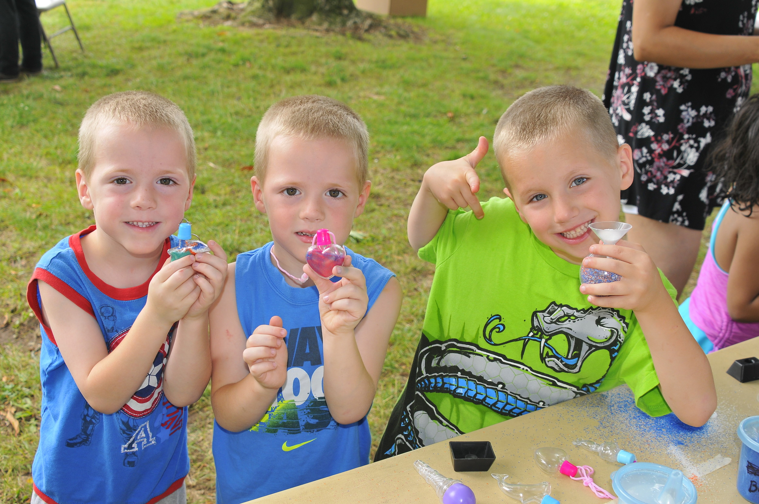 Blake, left, Kameron and Landon Tamberelli had a fun time creating sand art at the 20th annual Lazy Days of Summer festival in Levittown.