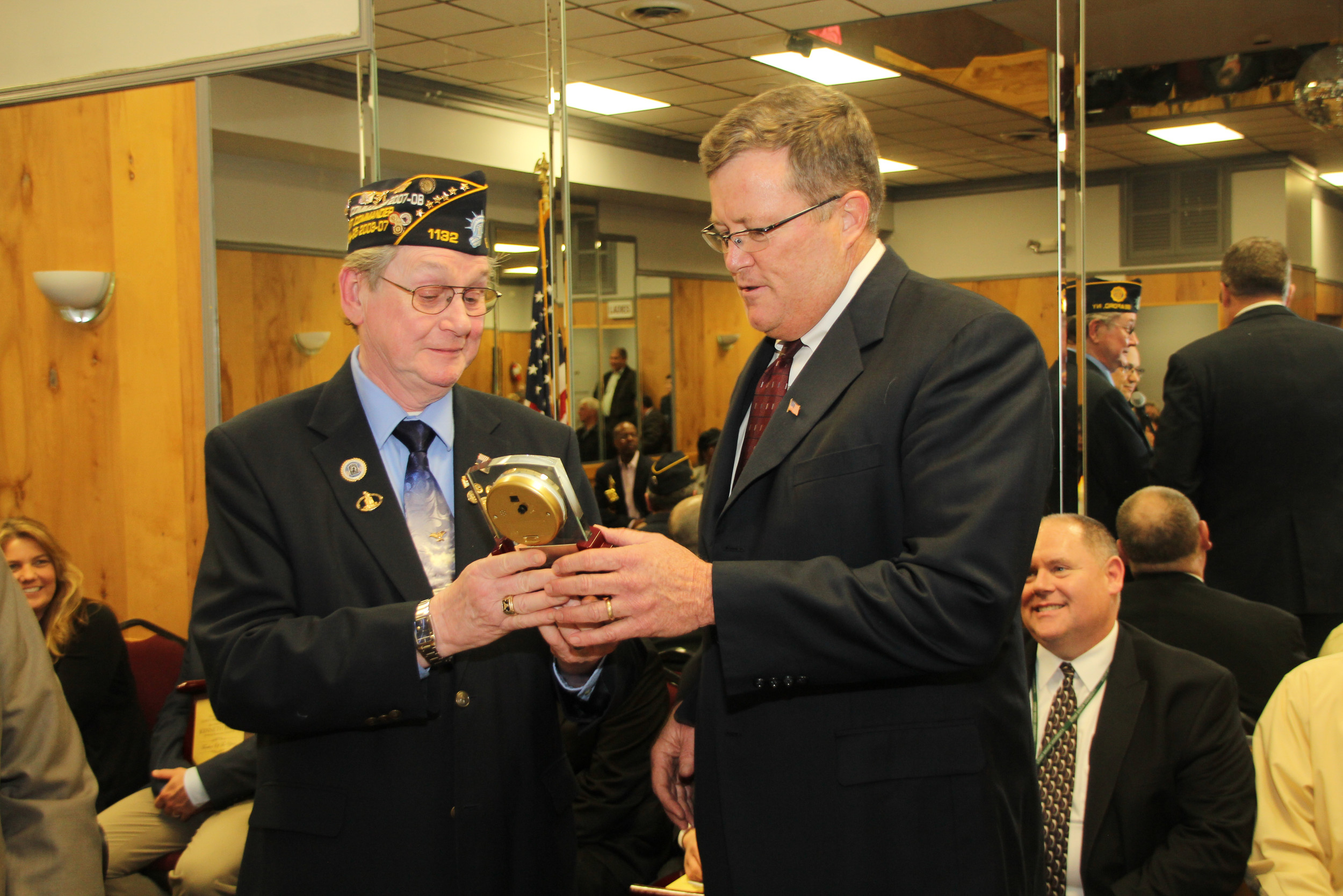 Bill Harms, commander of Seaford American Legion Post 1132, presented Brian Conboy with the group's Special Recognition Award in April. Several community organizations honored Conboy before his retirement this month.