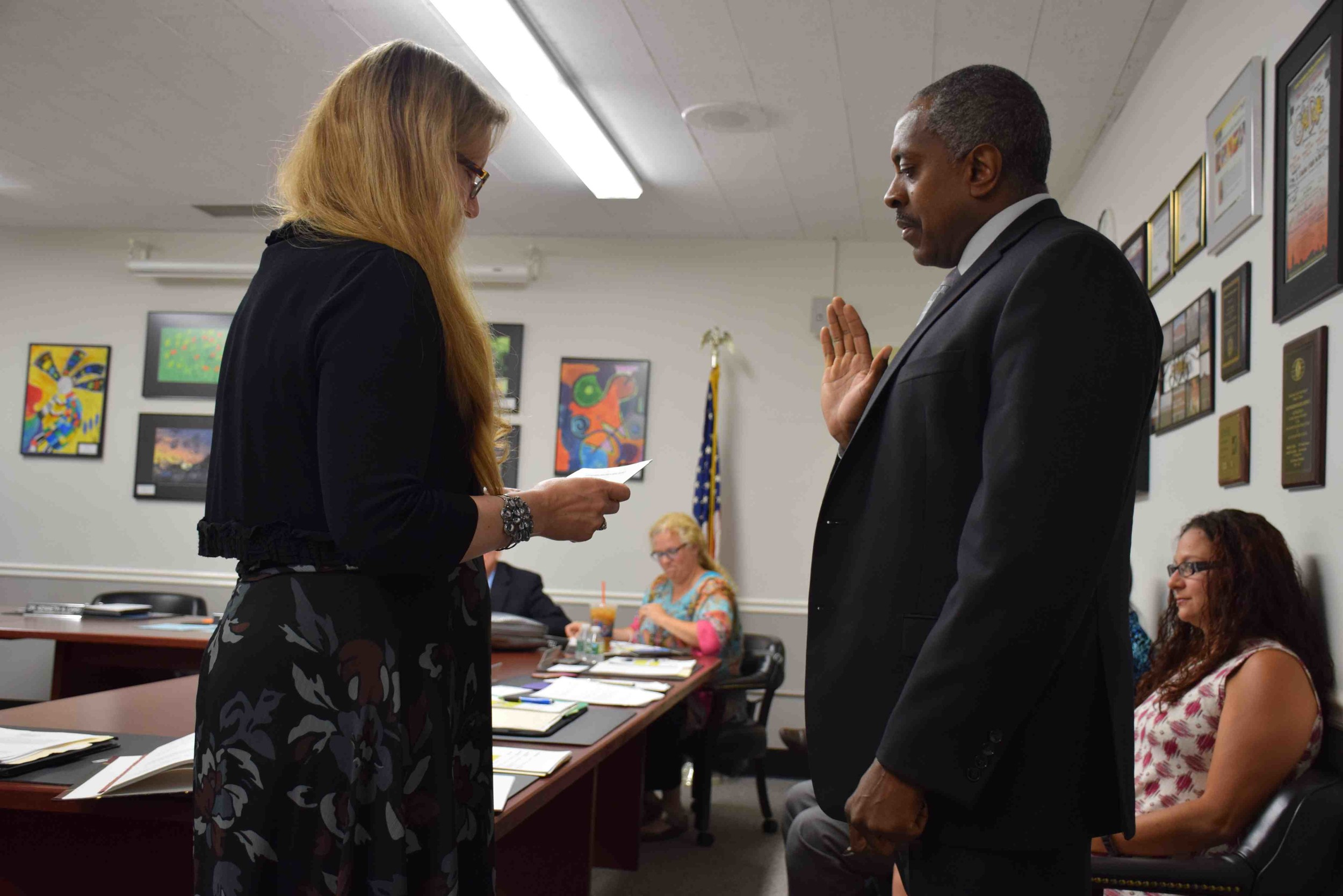 on july 6, superintendent of schools Dr. Kenneth Card Jr. took his oath of office, administered by district Clerk Jeanne Puma.
