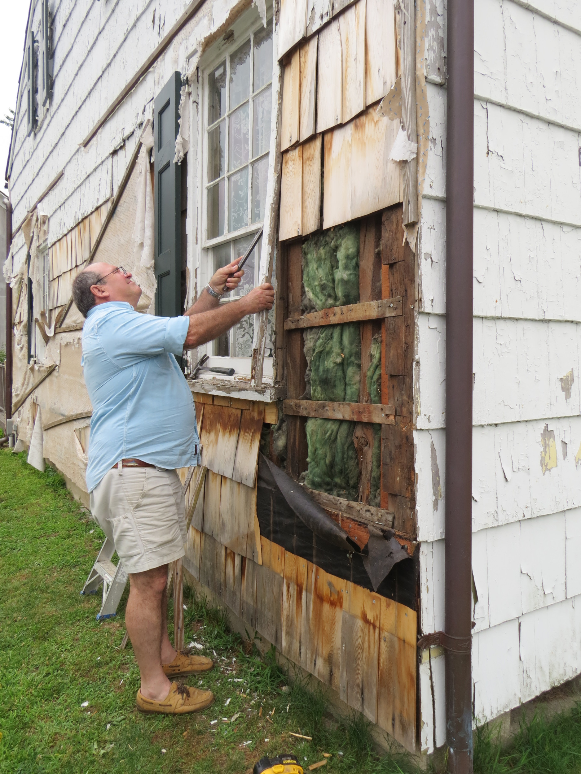 Charles Doering has been working on the windows on the east wall of the Earle-Wightman house.