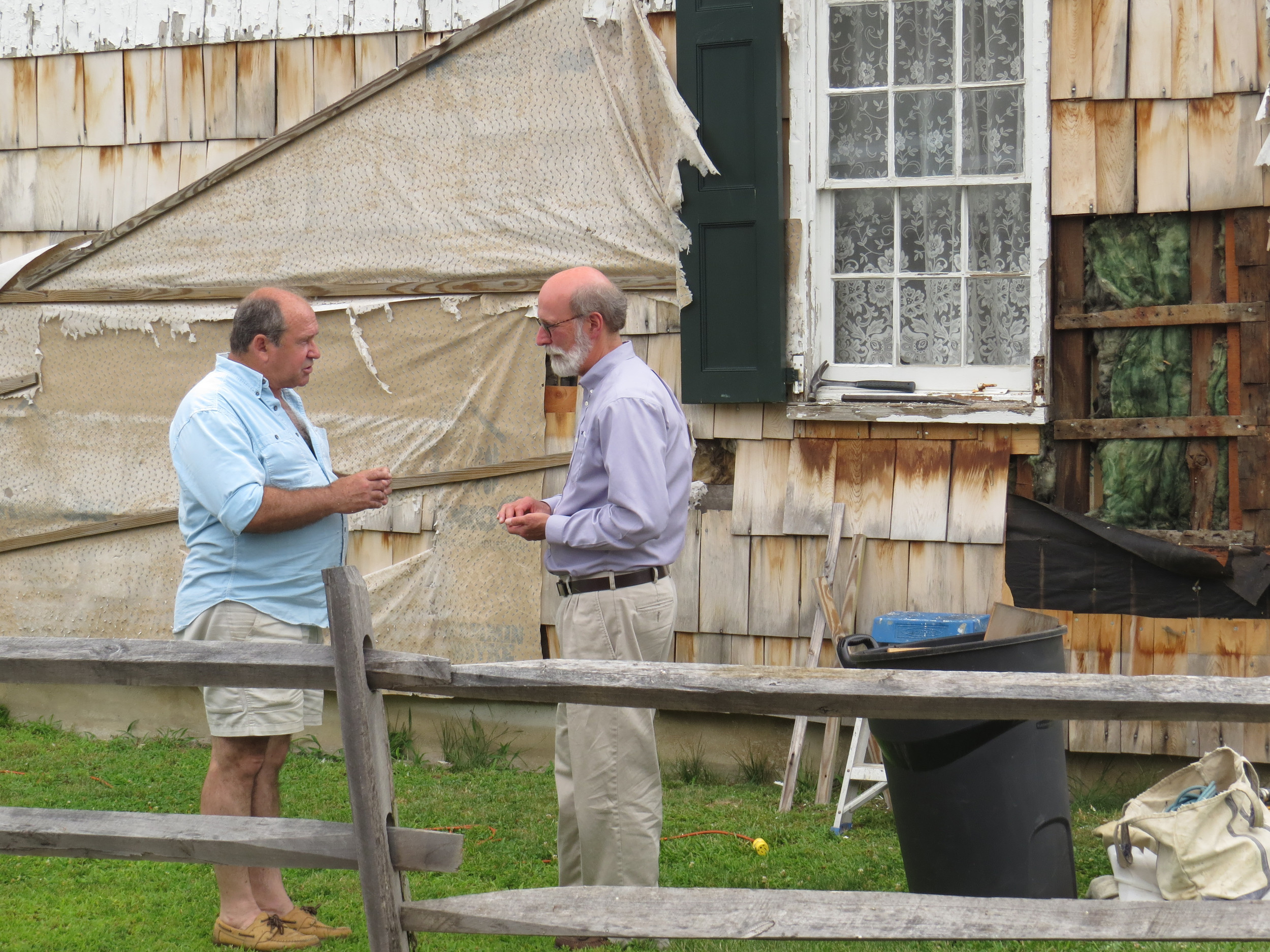 Charles Doering, left, discussed what needed to be done to the Earle- Wightman home with the O.B. Historical Society's Phil Blocklyn.
