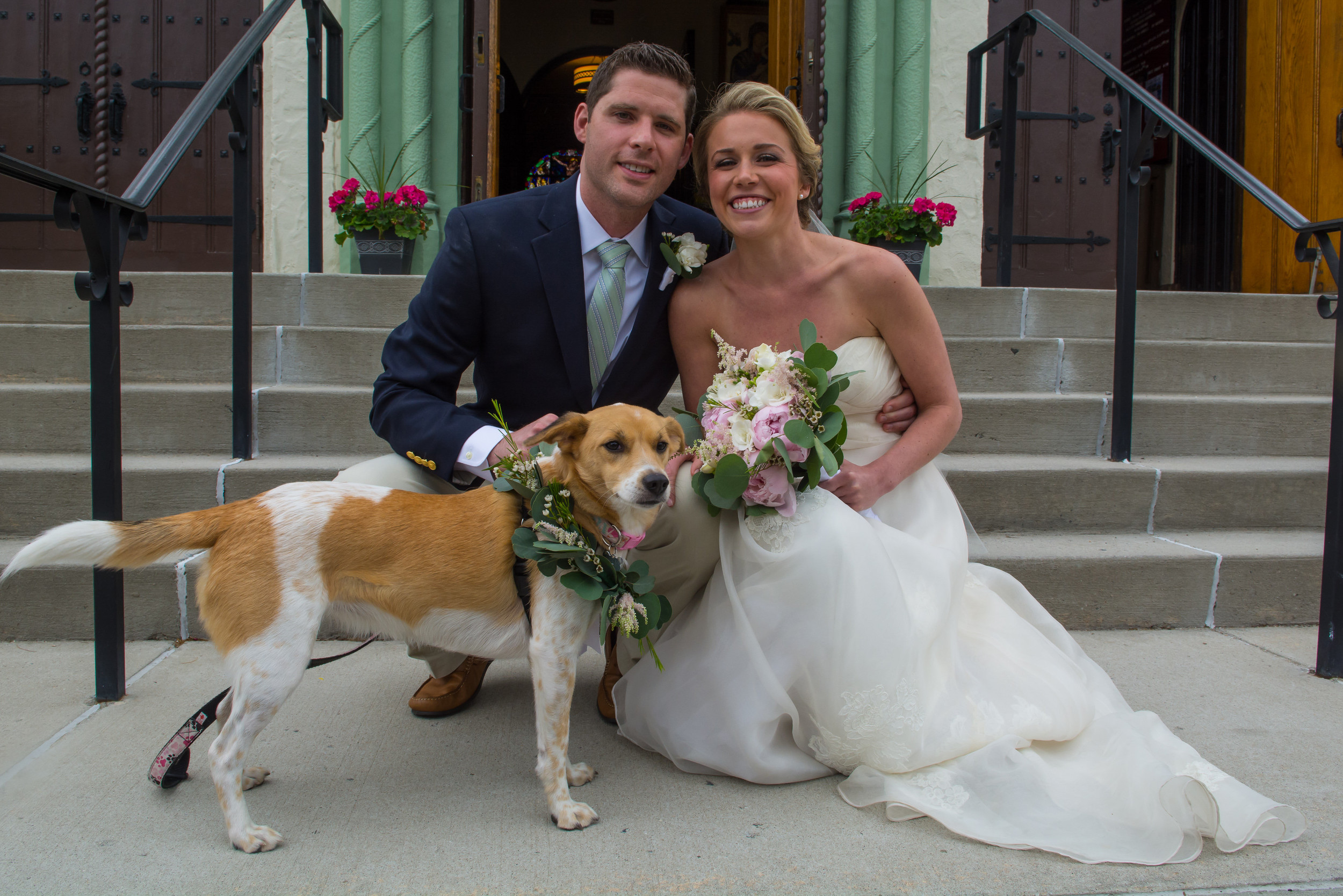 Caroline and Paul Carroll, above, with Lilly outside Our Lady of Lourdes in Malverne on their wedding day.