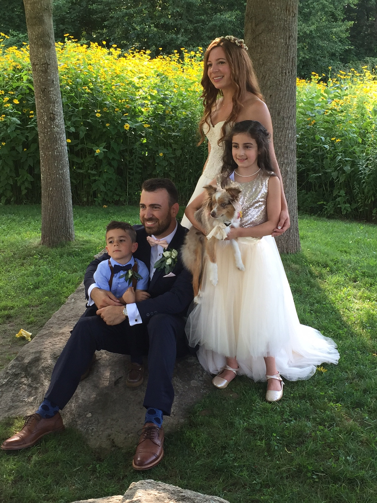 Newlyweds Andrea Swift Argyros and John Argyros last week with their flower girl, ring bearer and dog, Mila.