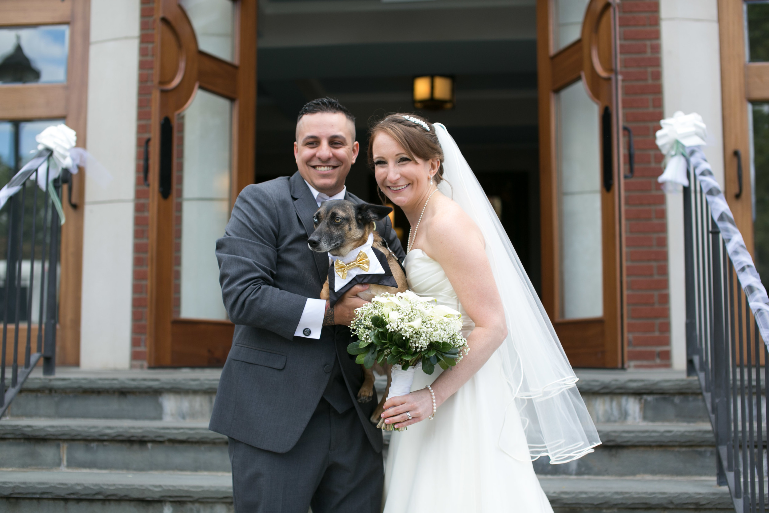 The Silvas on their wedding day with their dog JakeBear. Veronica had the idea to start Pawfect For You after having difficulty managing care for her dog during her own wedding.