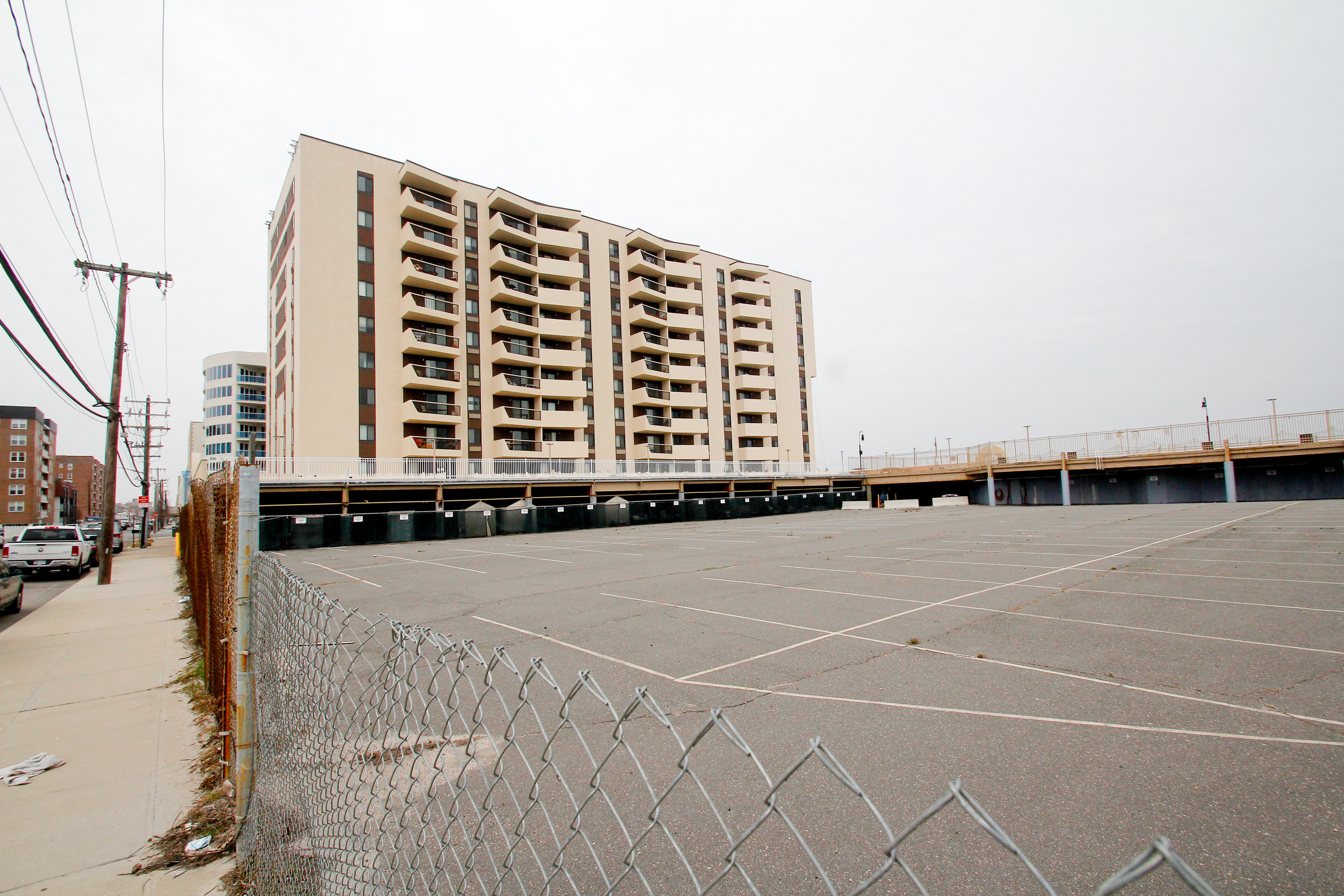 A developer alleges that the city zoning board bowed to pressure from unit owners of Sea Pointe Towers, above, at 360 Shore Road, when it revoked permits for the construction of adjacent condominium buildings.