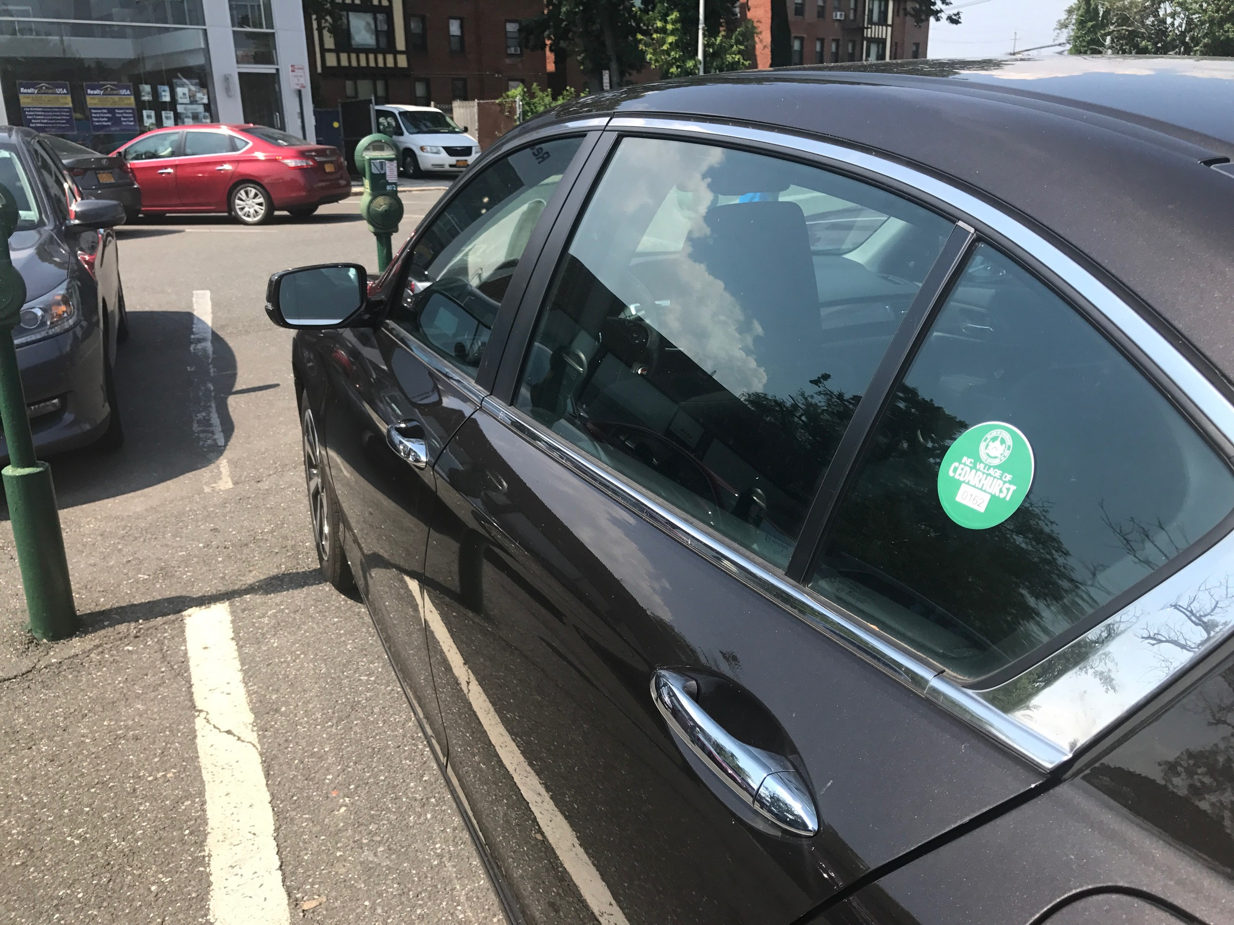 Some Cedarhurst residents with permits have had to use metered parking spaces in recent weeks.