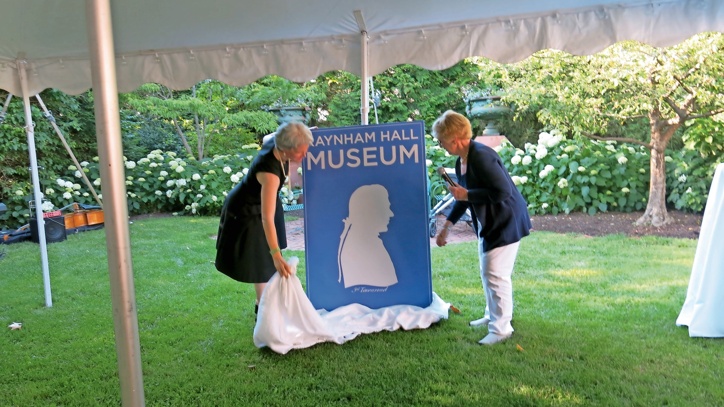 Harriet Gerard Clark, Raynham Hall's executive director, left, and Barbara Adelhardt, a member of the hall's board of trustees and its marketing chair, unveiled the new logo.