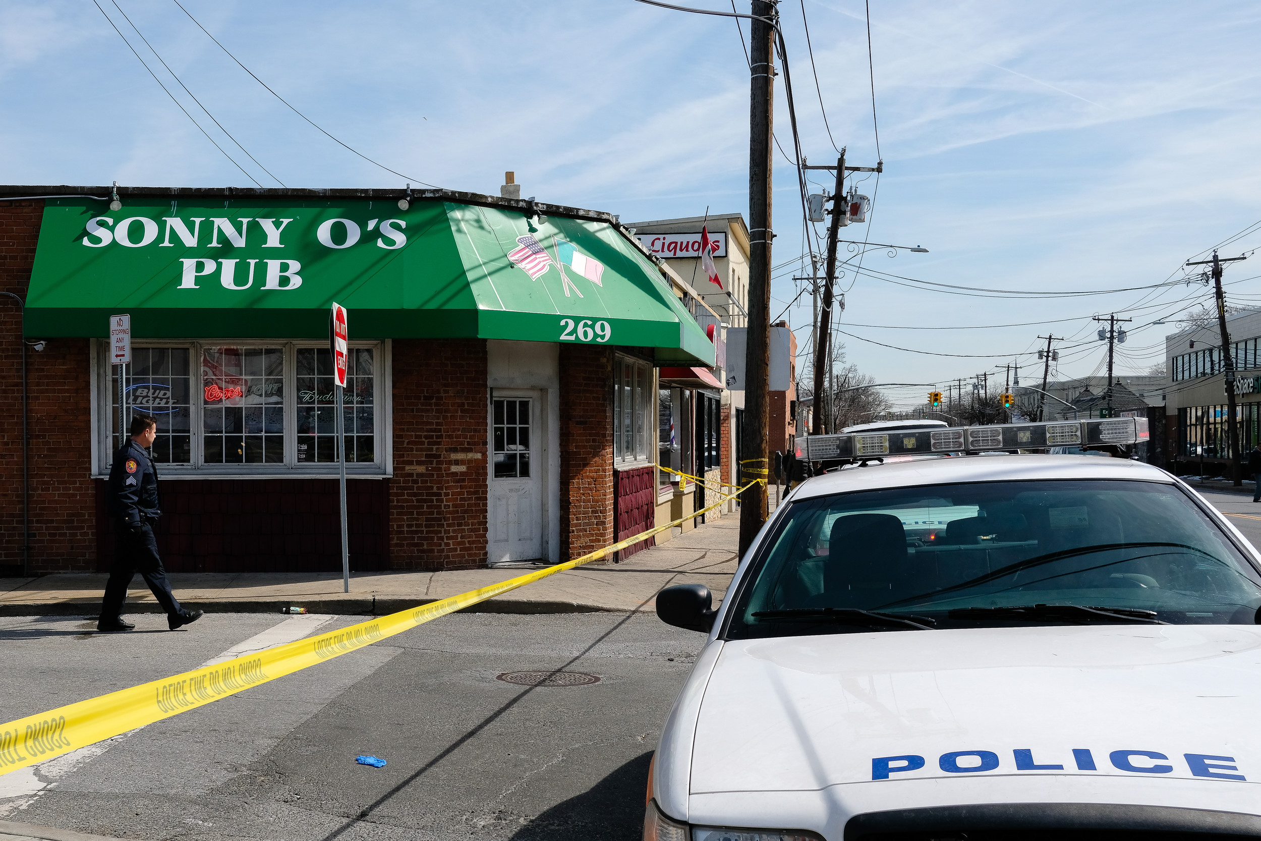 Nassau County police on the scene at Sonny O's Pub on March 13, where a man was shot and killed.
