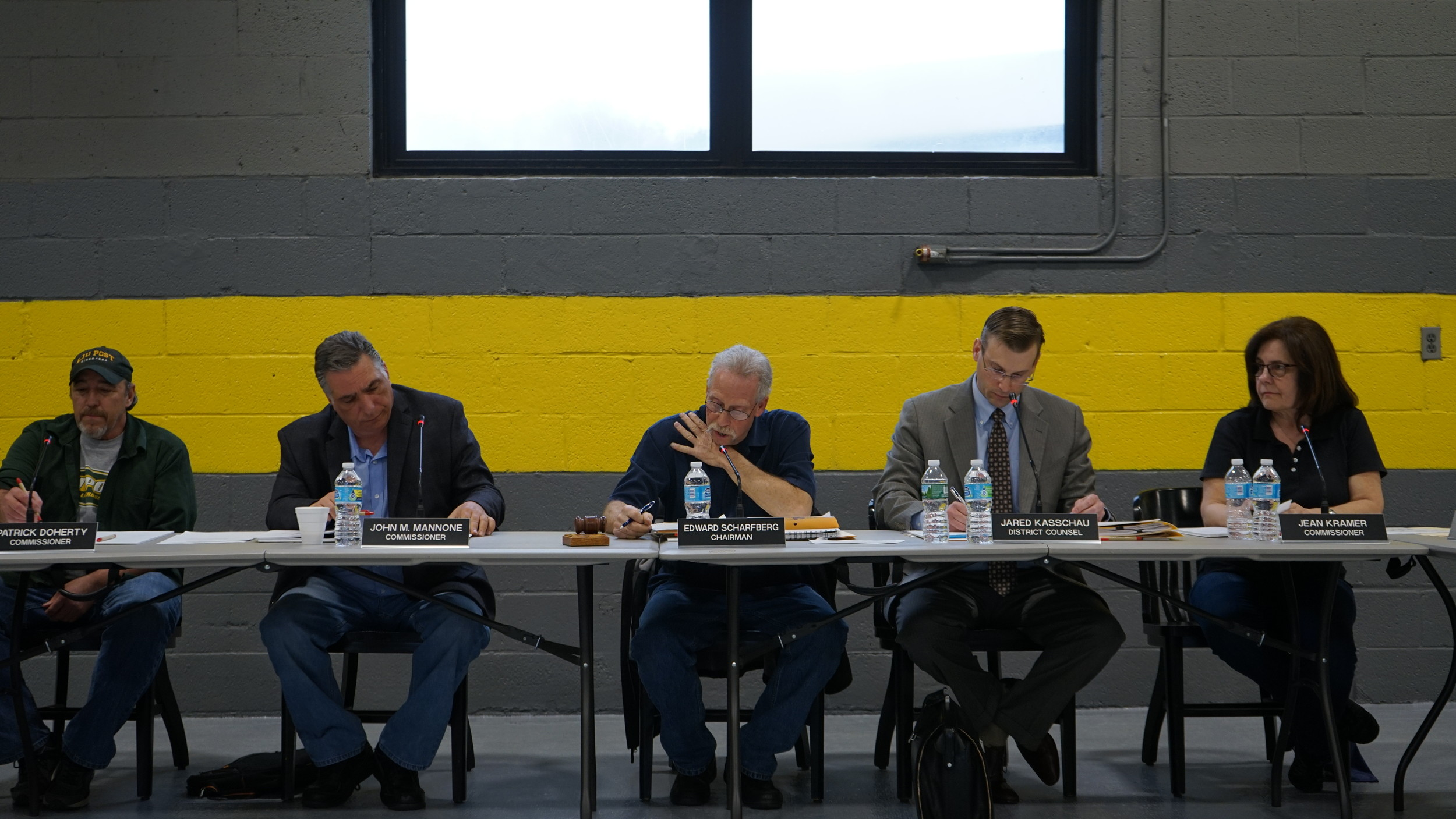 Sanitation District No. 7's board of commissioners on May 4. The latest suit against the district alleges that former sanitation Commissioner Jean Kramer, far right, and former board Chairman Ed Scharfberg, center, and others retaliated against sanitation worker Richard Zappa for his public support of incoming commissioner and current Chairman John Mannone, second from left, during his 2015 campaign.