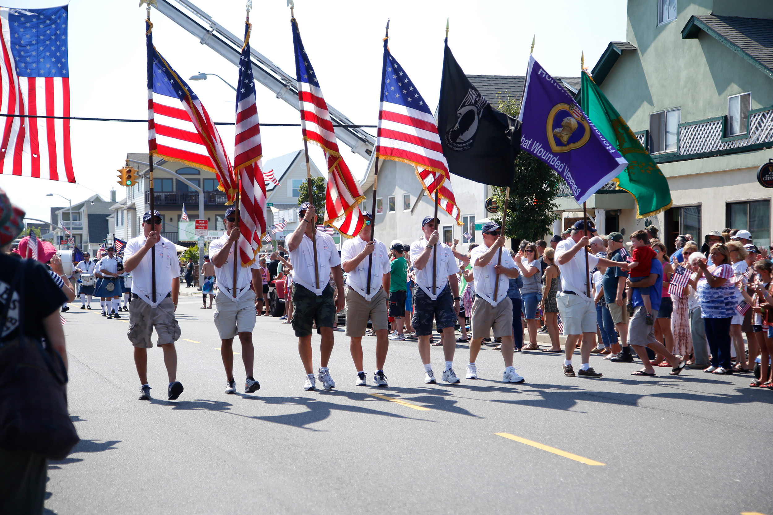 The local Veterans for Foreign Wars and other military service organizations marched in the parade with wounded veterans visiting Long Beach.