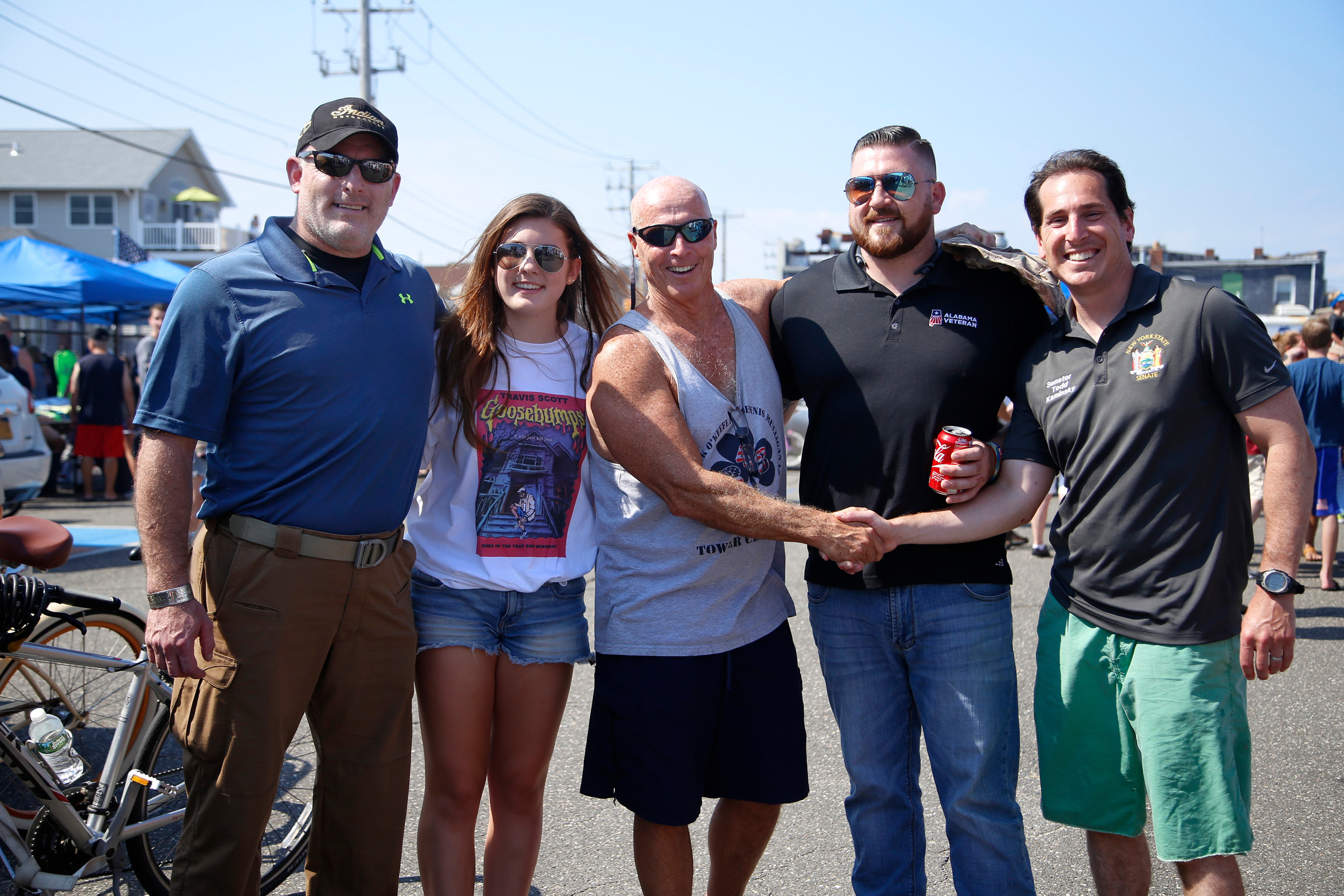 U.S. Marine Corps Gunnery Sgt. Glen Silva, Elizabeth Silva, Long Beach Waterfront Warriors co-founder Jerry Snell, Pat Johnson, of the Homeless Veterans' Initiative USA, and State Sen. Todd Kaminsky.