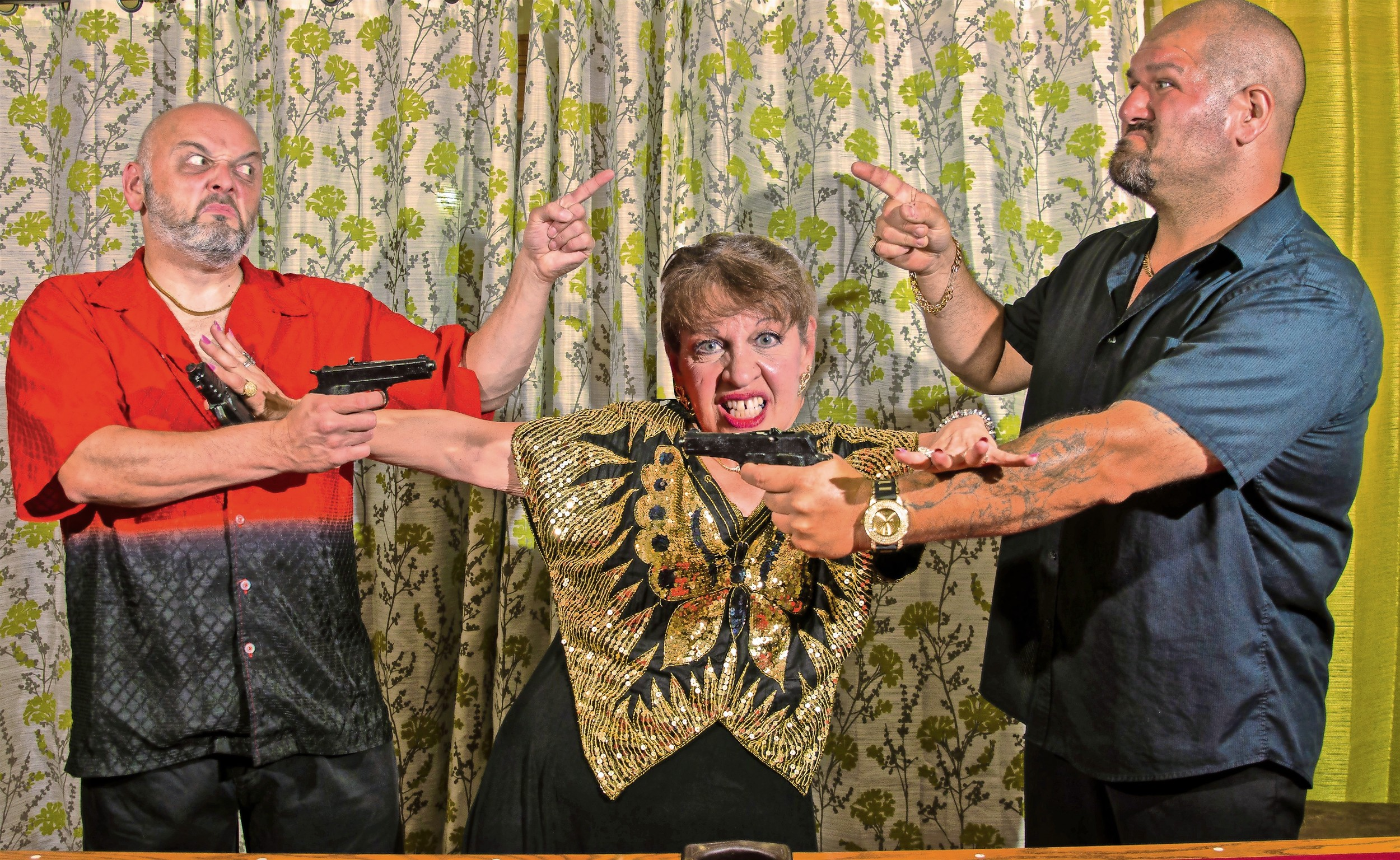 "Tony Walker, left, of Wantagh; Linda Bartolomeo, of Mastic; and Sal Catura, of Wantagh, performed a mob-themed show, ""The Family, The Fun & The Felony,"" with a local troupe called Knock 'Em Dead Comedy."