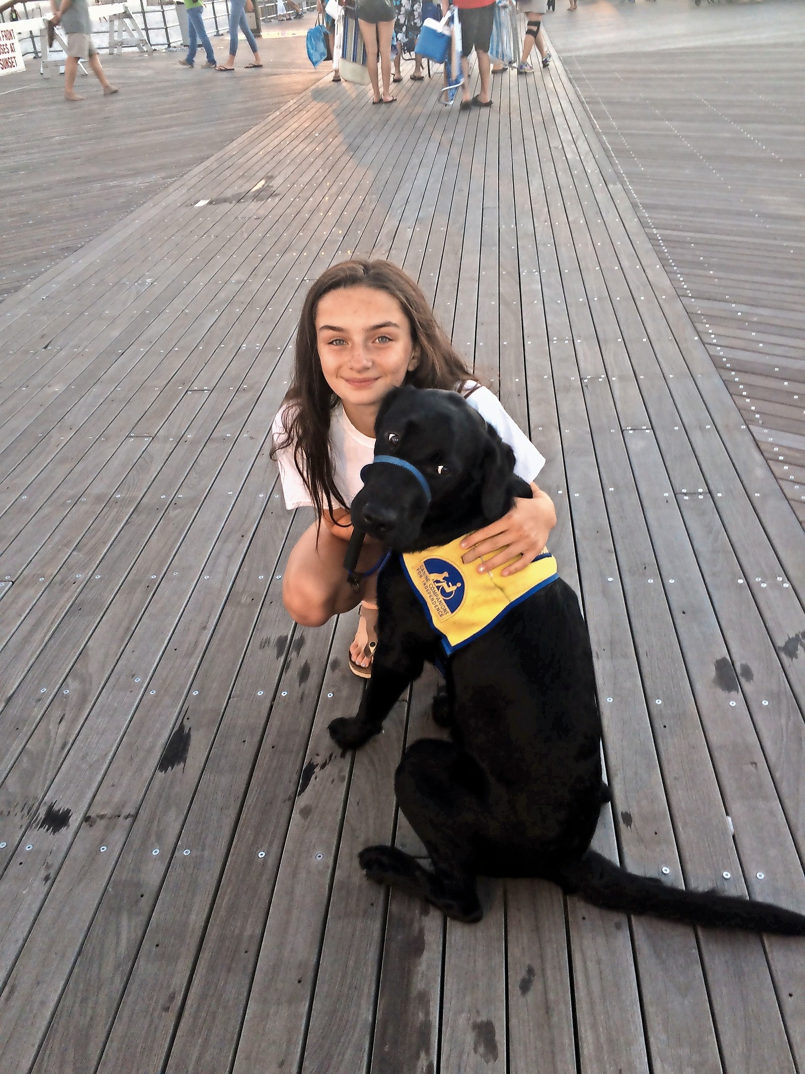 Meredith Kass, 16, of Seaford, took Fred III for a walk at Jones Beach two years ago. Her family  raised him for Canine Companions for Independence — a nonprofit that gives assistance dogs to people with disabilities.