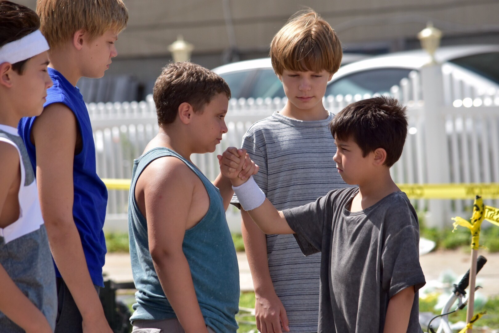 Colin Critchley (Sal), far left; Harrison Wittmeyer (Billy), James DiGiacomo (Dom), Tanner Flood (Brian), and Maxwell Apple (John) were cast in the roles of Budion and his friends as children.