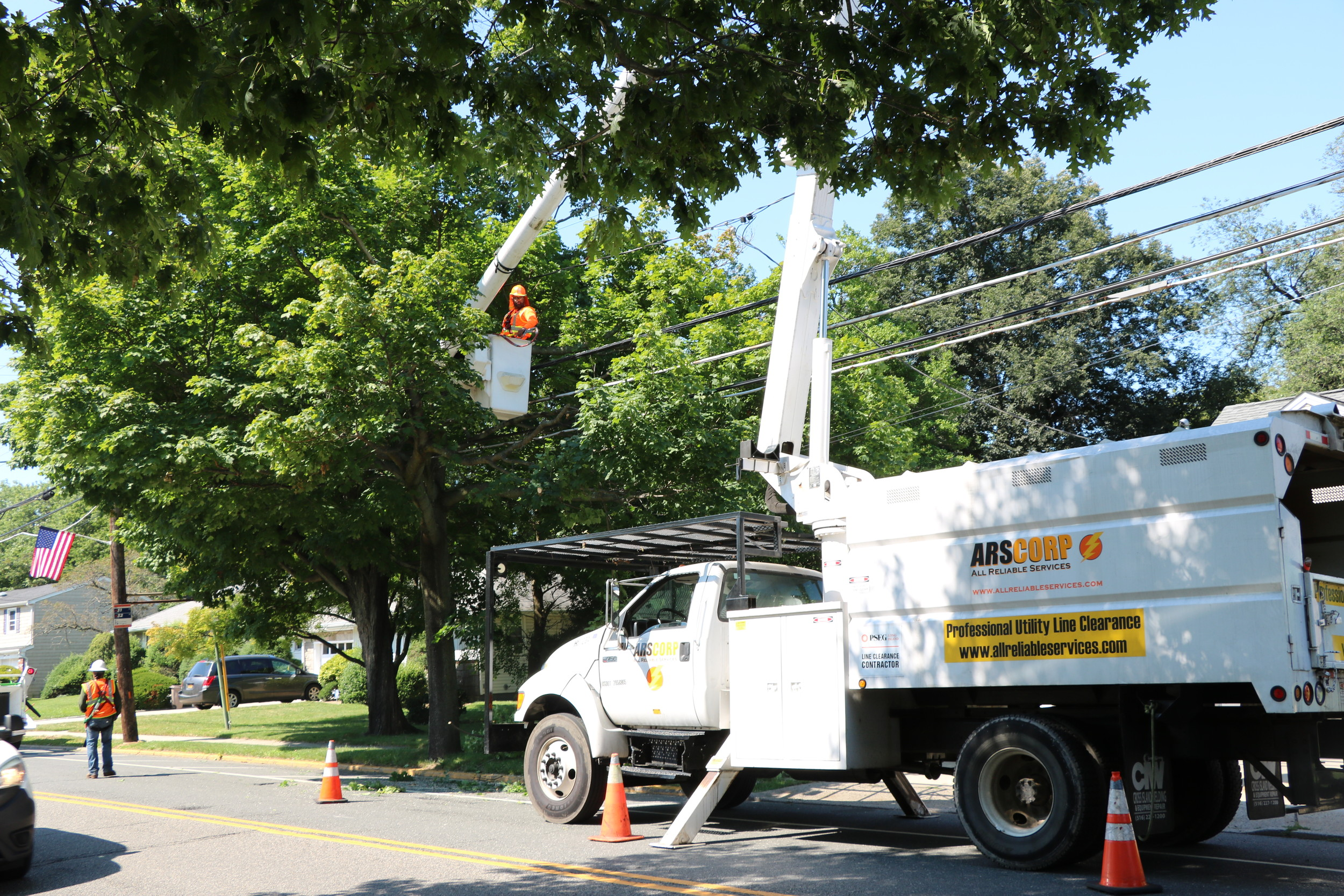 a PSEG Long Island contractor trimmed trees along Hempstead Avenue in Malverne on July 31.