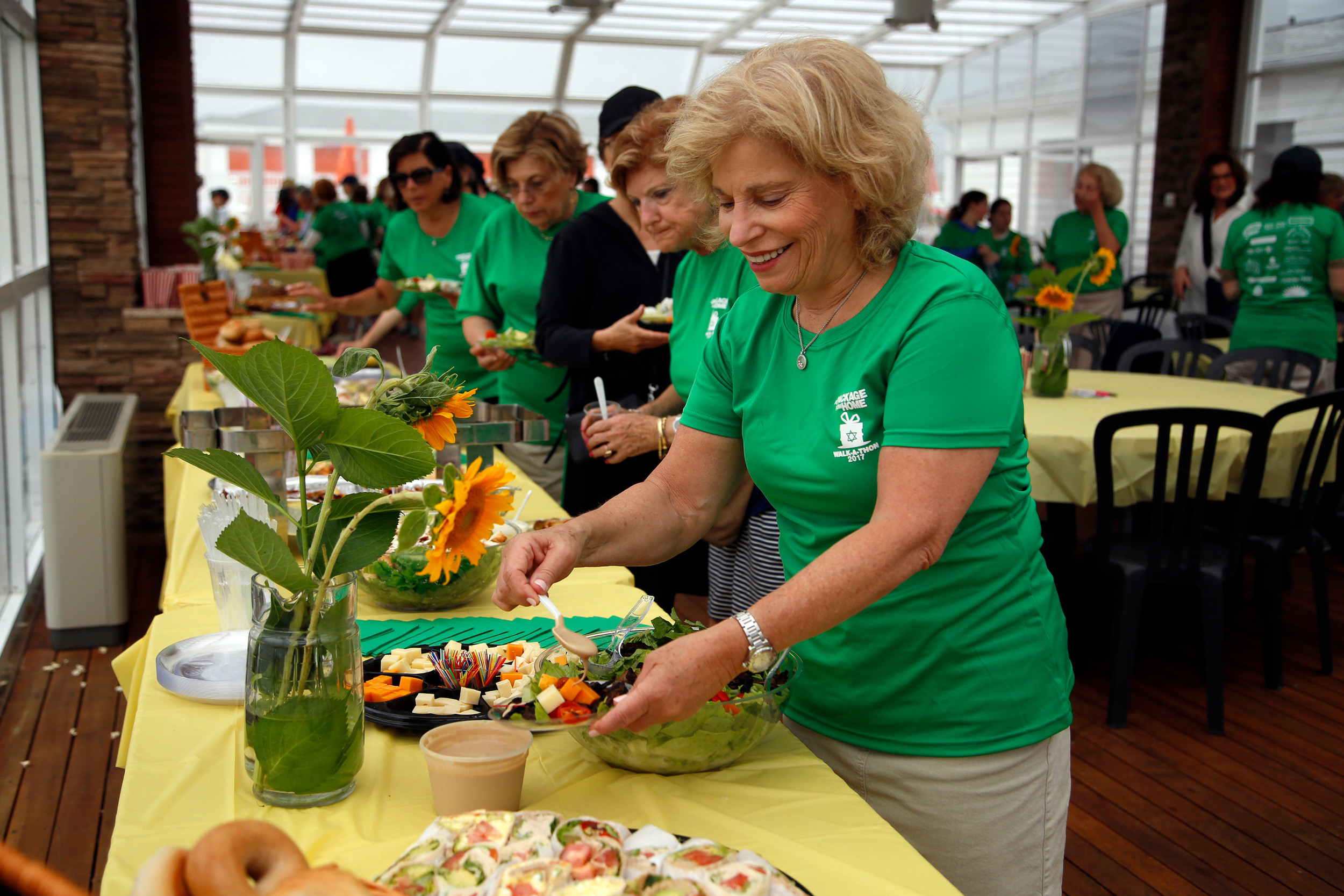 After the walk brunch was served at Sunny Atlantic Beach Club. Lynda Brafman drizzled some dressing on her salad.