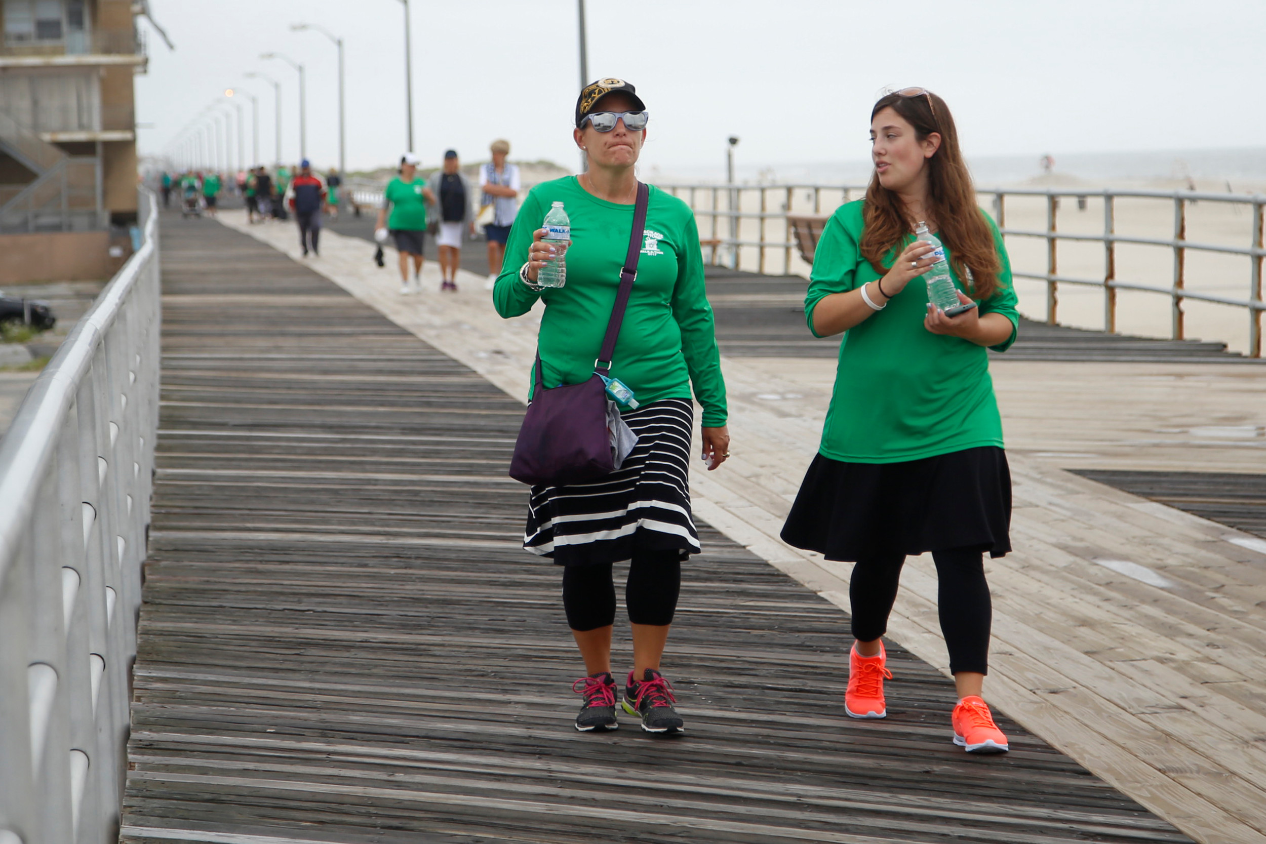 On the boardwalk in Atlantic Beach, Mia Weiss, left, and Michael Wulwick, were among the supporters for A Package From Home.