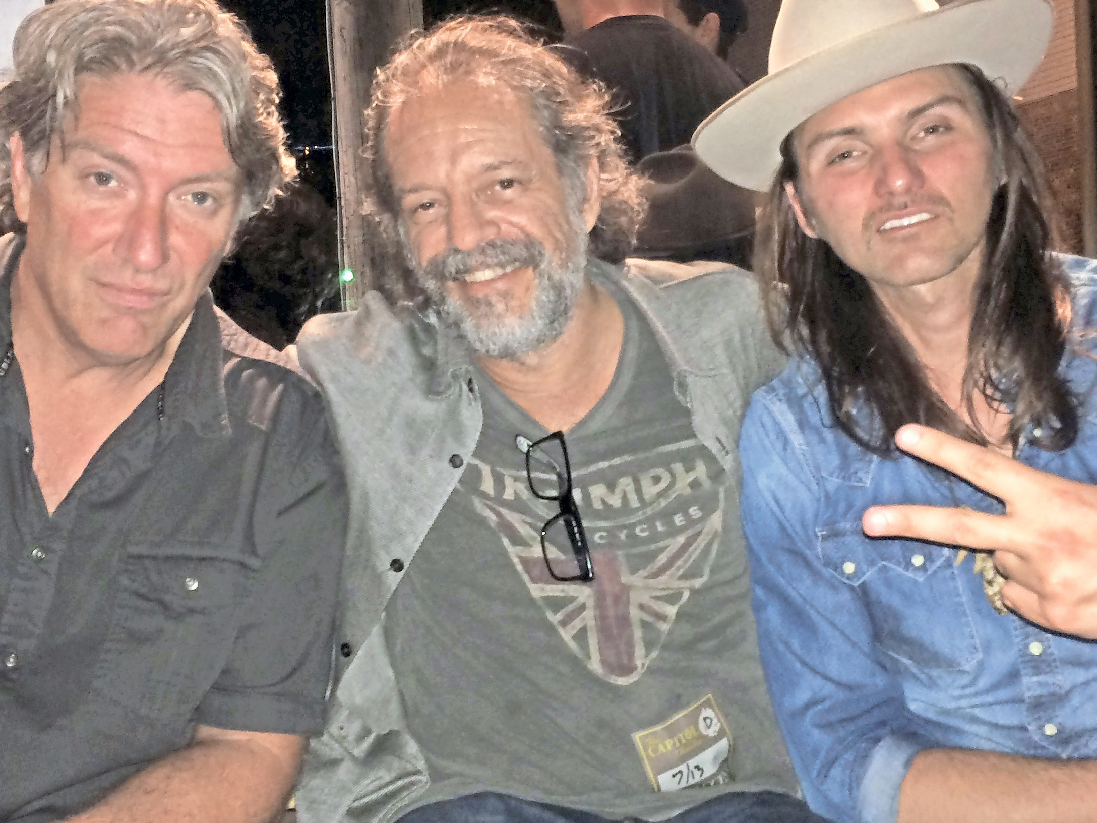 Sea Cliff musicians Chris Kinnear, from left, and Andy Aledort with Dickey Betts's son, Duane, after a Dawes concert in which Duane Betts performed last July.