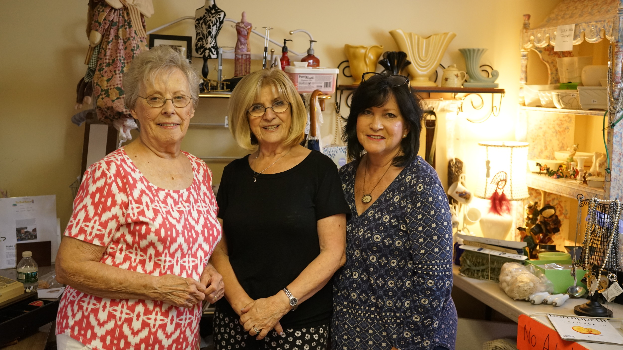 Jill Reilly, Nancy Gray and Kathy Buckley, the thrift store's volunteer workers