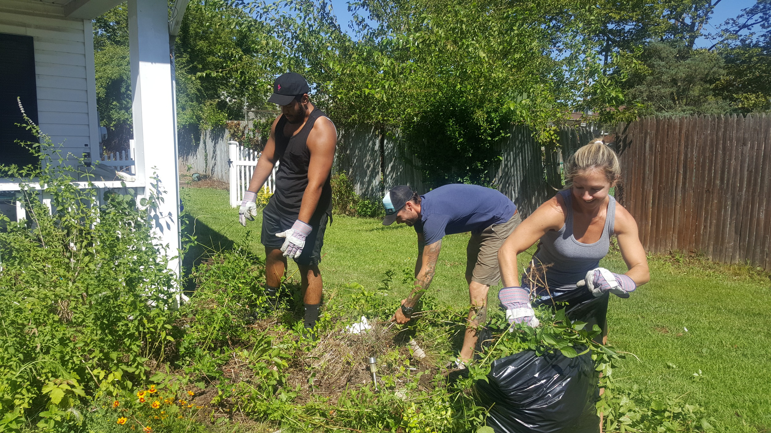 On Sunday, Long Beach real estate agent, Suzanne Wildes, right, her husband, Charles Wildes, center, and friend Danny Alicea, left, helped Collins clean up her father's home.