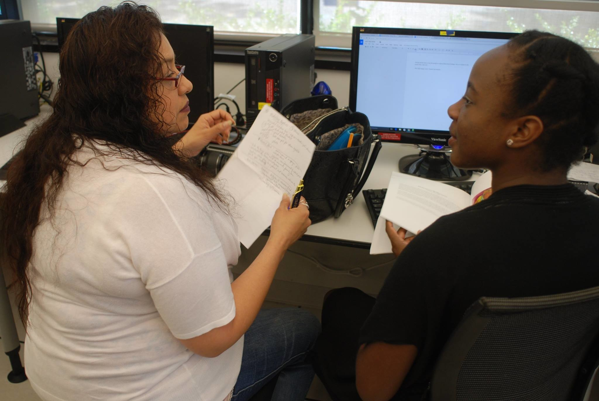 Vanessa Parker, editor of the Franklin Square-Elmont Herald, worked one-on-one with Mikelley Baptiste, an Elmont High junior.