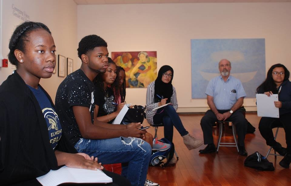 "Mikelley Baptiste, far left, was a recent participant in the Hofstra University High School Summer Journalism Institute, funded by the New York Press Association and Press Club of Long Island. Mikelley, an Elmont High School junior, is seen here during a tour of Hofstra's Emily Lowe Gallery, led by museum educator Elizabeth Dysart. Mikelley reviewed the show ""Converging Voices: Gender and Identity."""
