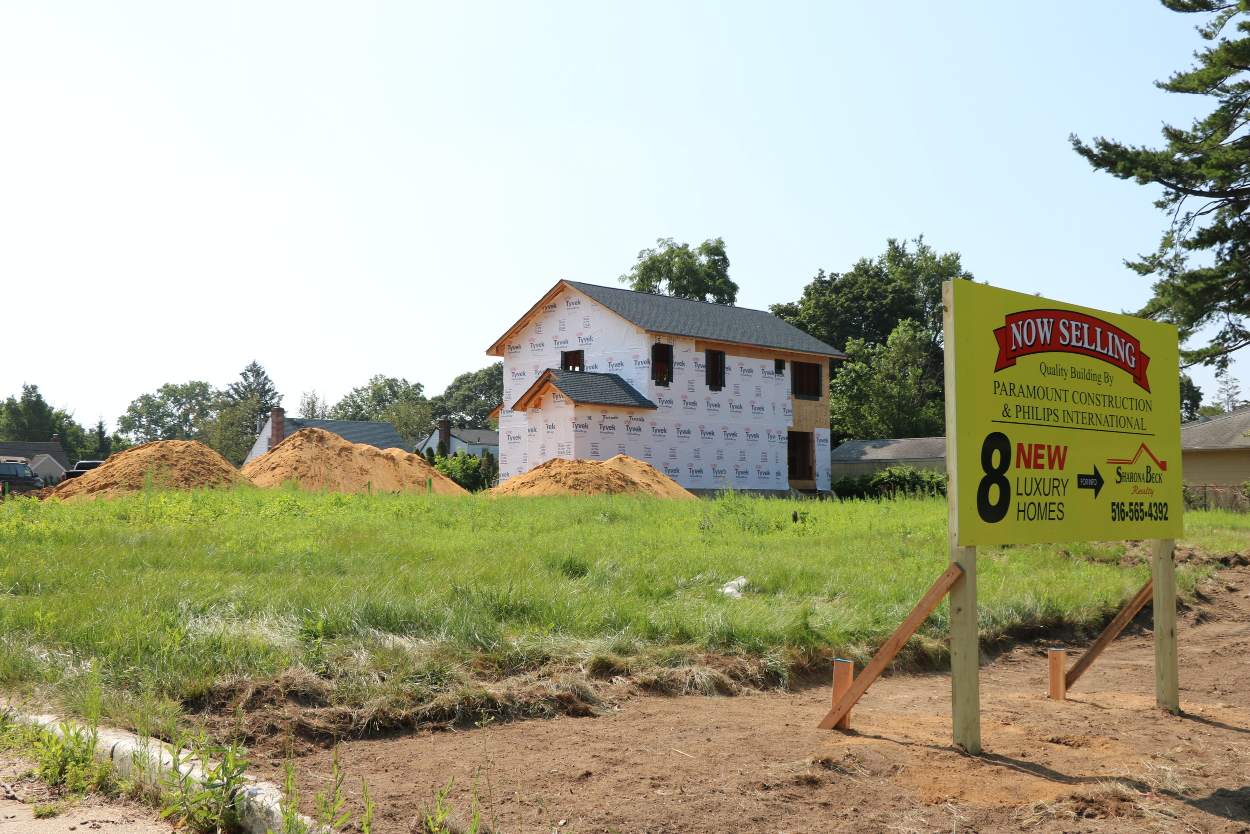 Eight new luxury homes being built at 764 Hempstead Ave. are selling for $925,000 and up. They will occupy land once owned by the Gaeta family.