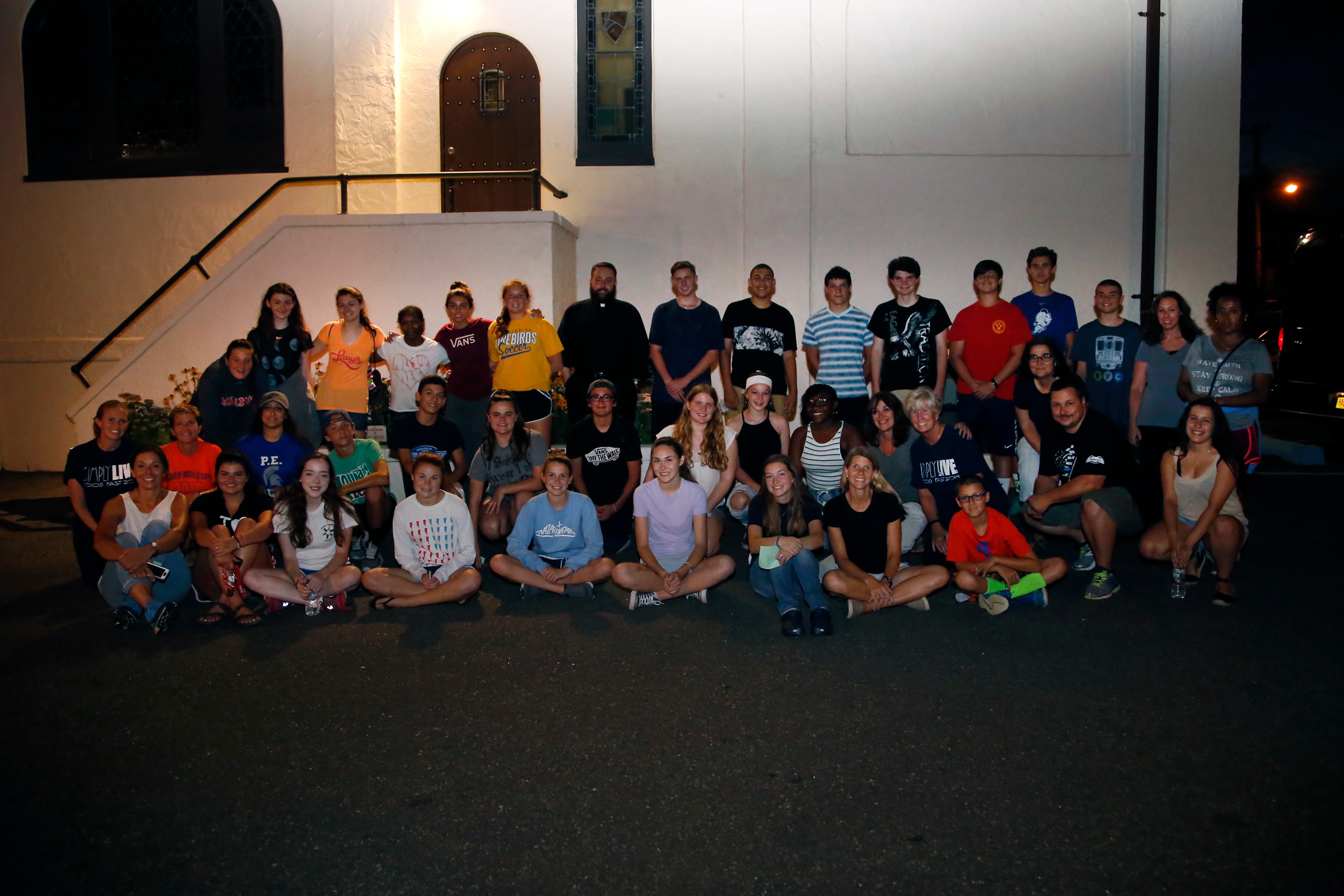 Midnight Run volunteers gathered at Our Lady of Lourdes Church prior to leaving for Manhattan to help the city's homeless.