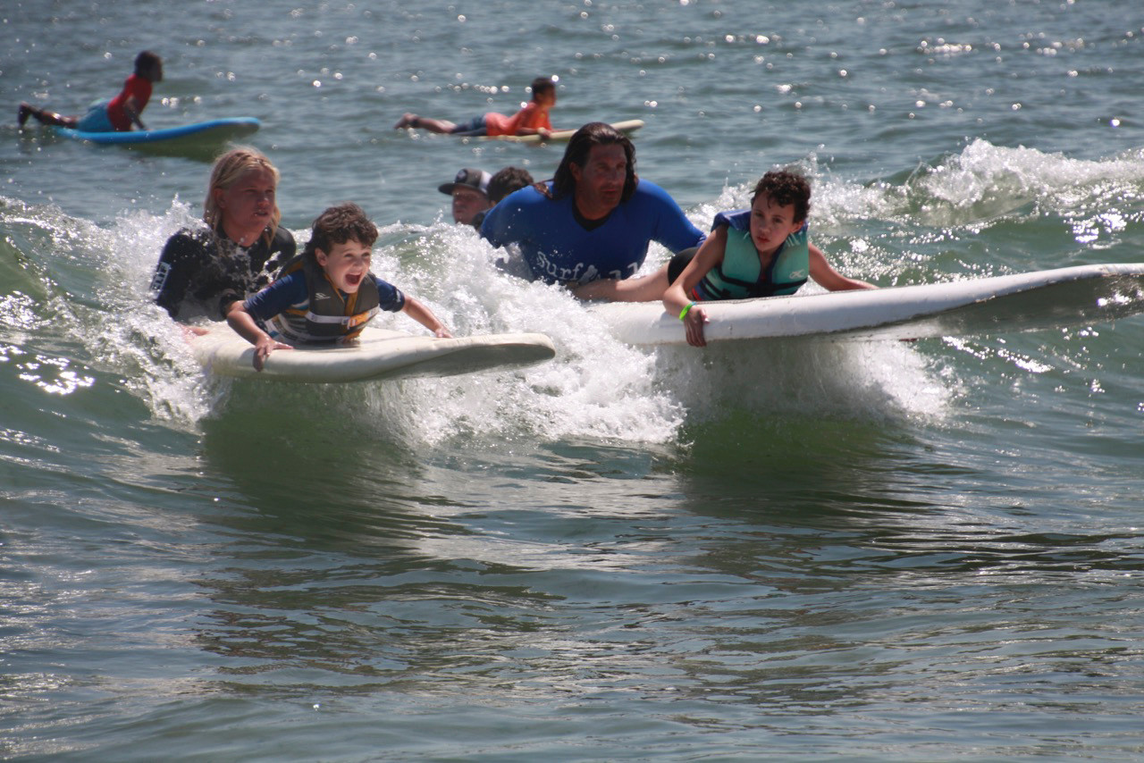 Camp Friendship campers Koby Kahan, left, and Shoshana Simon were among the 15 children who received surfing lessons from Surf for All.