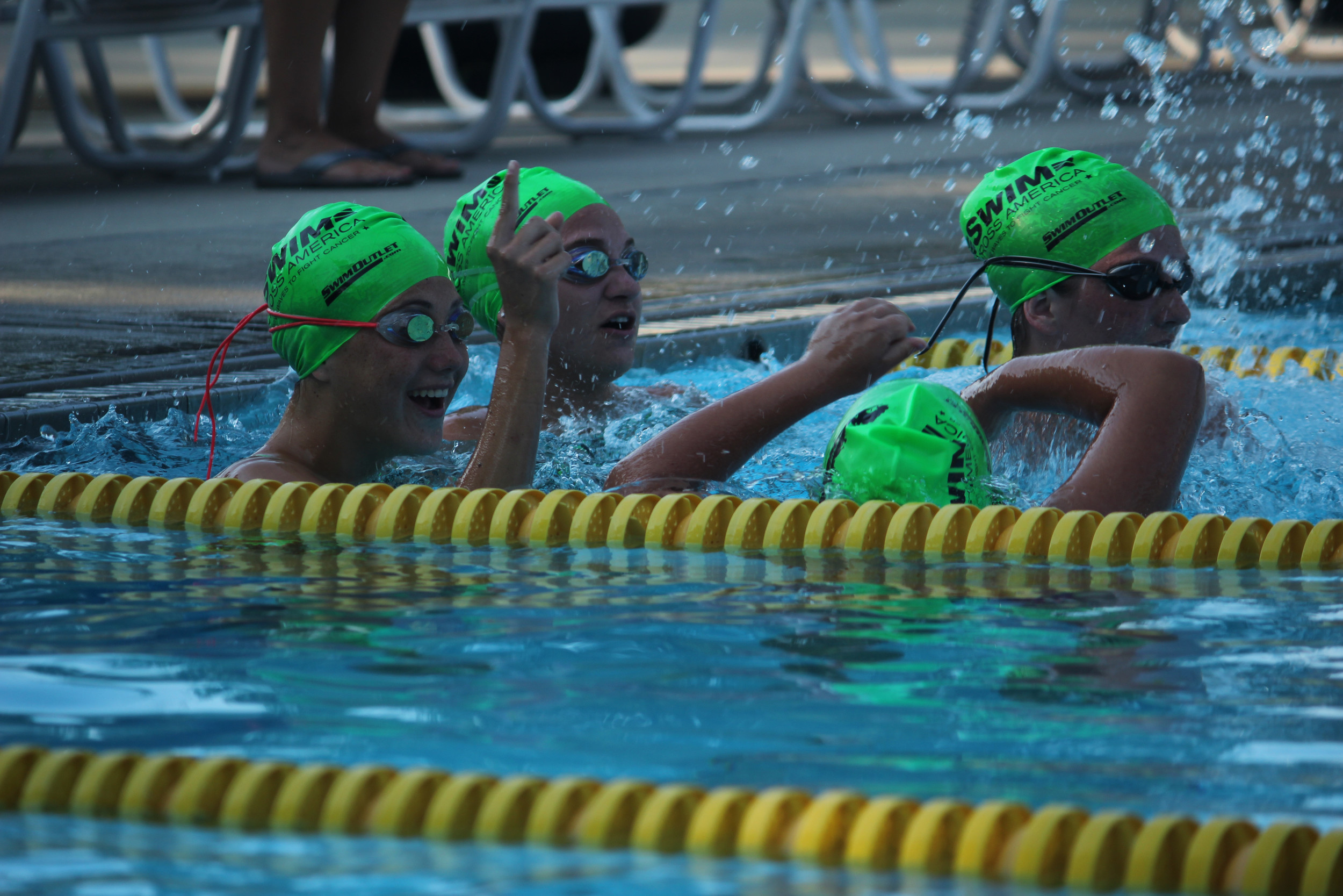 Members from the Lynbrook High School varsity swim team cheered each other on as they took turns swimming laps.