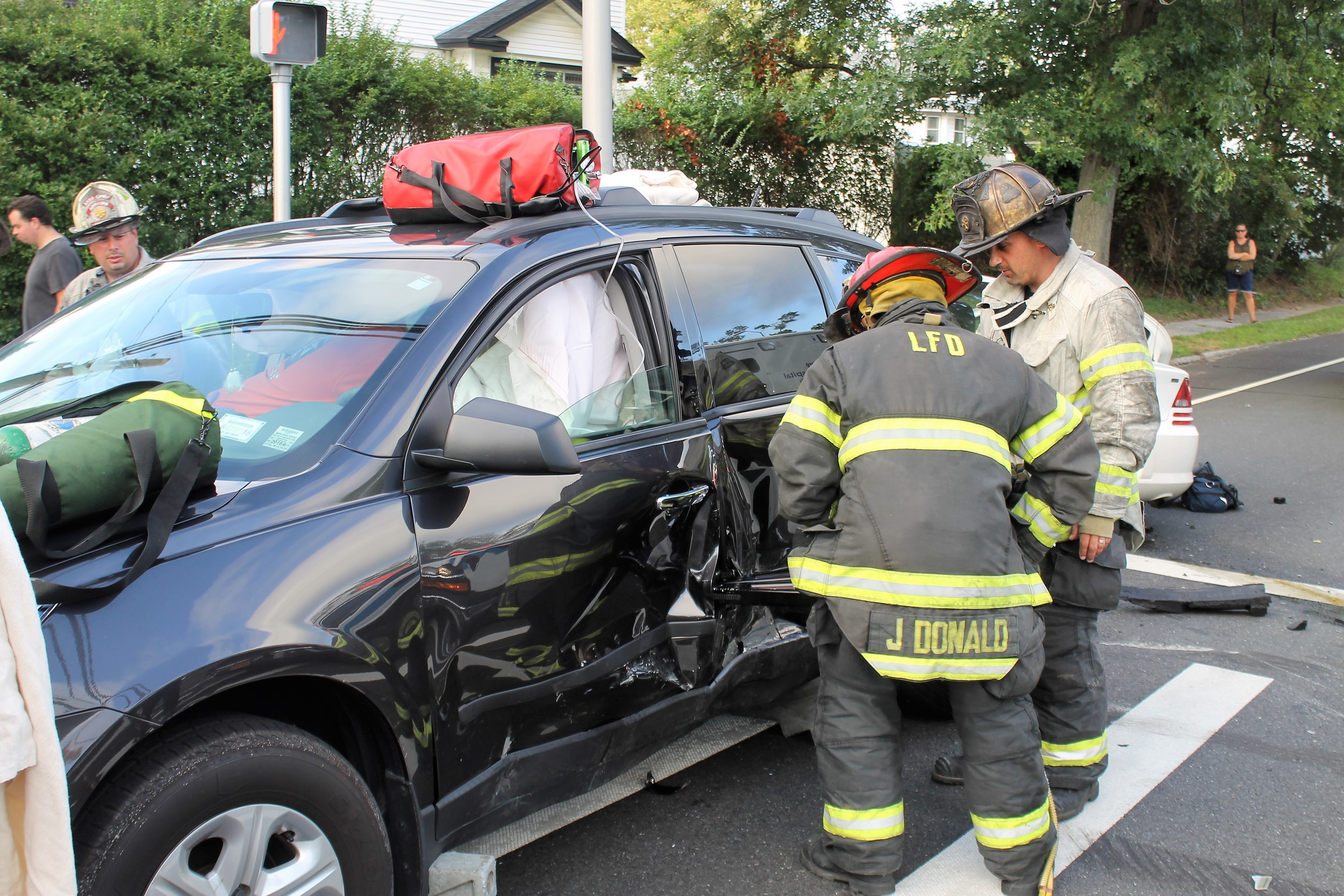 The driver of an SUV had to be cut out of her car by Lynbrook firefighters on Aug. 4
