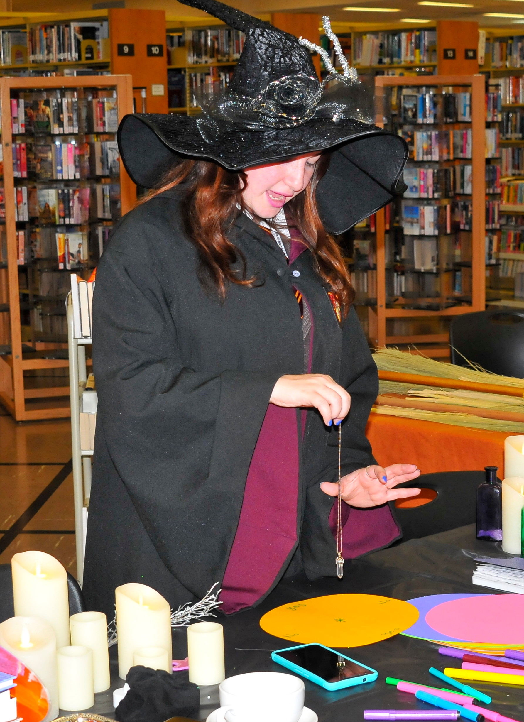 Librarians dressed in wizard robes demonstrated potion, want and broom making for children at Harry Potter's birthday celebration