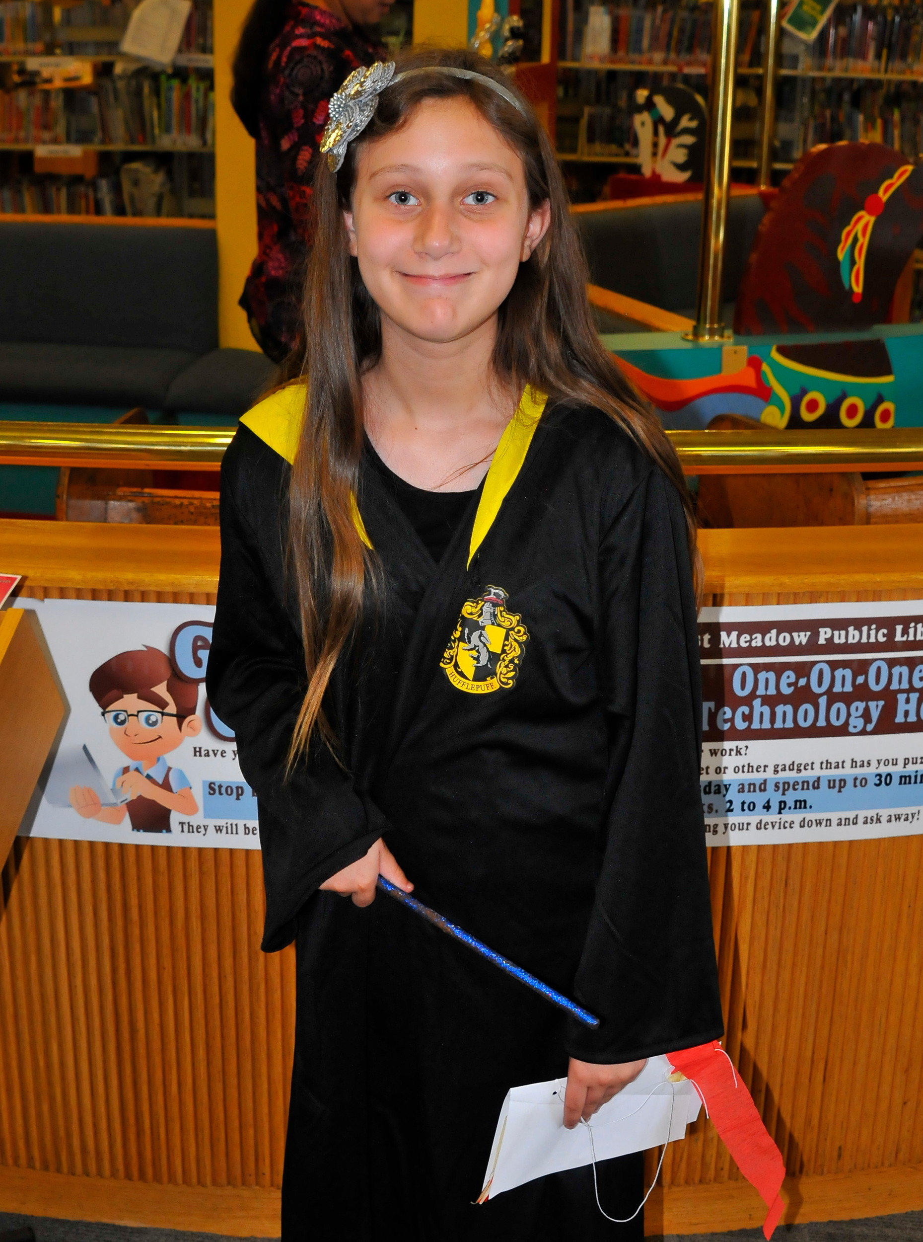 Dressed in a Hufflepuff House robe, Sharon Puma, 10, of East Meadow, crafted a broom.