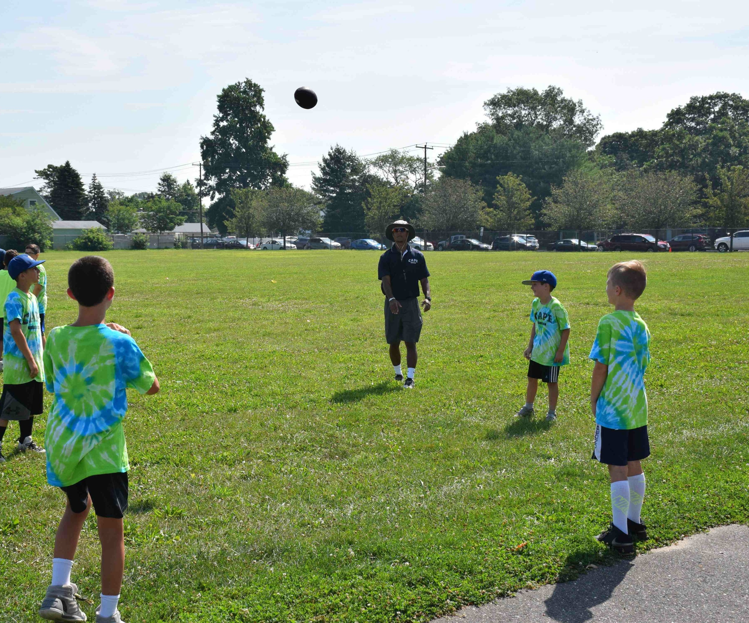 Students in the Creative Arts Program of East Meadow tossed around a football before their flag football game, one of the activities offered through the district's summer recreation program.