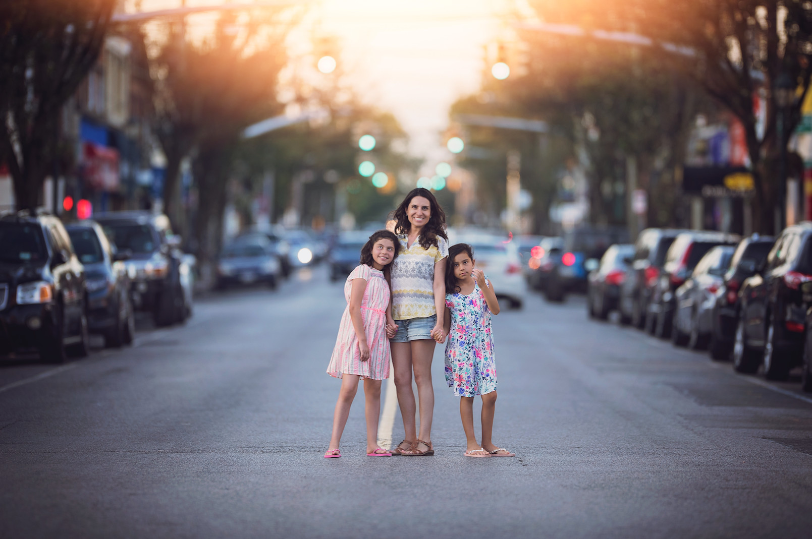 Barrera's sister, Cristina, center, with her two daughters, Gulianna, 12, left, and Rafaela, 10, on Rockaway Avenue in Valley Stream.
