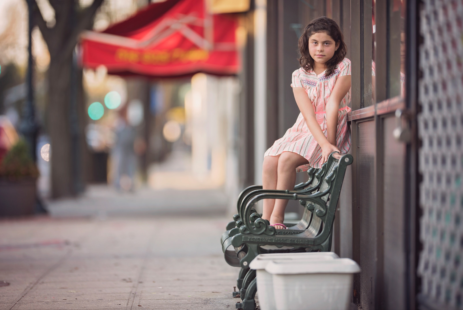 Gulianna Barrera, 12, Marcelo's niece, posed in front of the iconic Walt Itgen's Ice Cream Parlour storefront in Valley Stream.