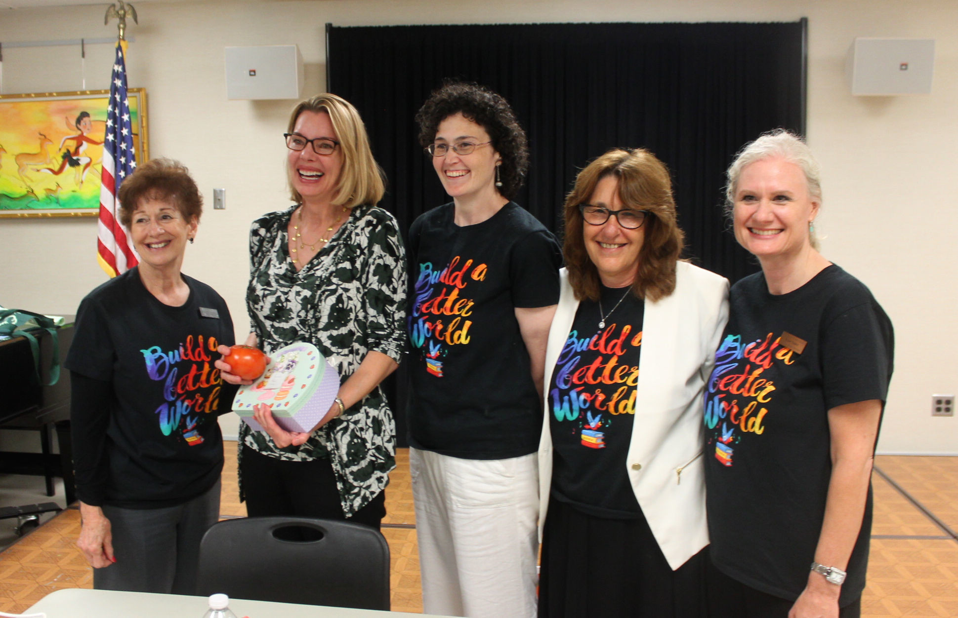 "AT the Adult Summer Reading head of reader services Marcia Blackman, far left, ""The Dollhouse"" author Fiona Davis, Janine Walsh, Donna Ballard and Susan Saskin."