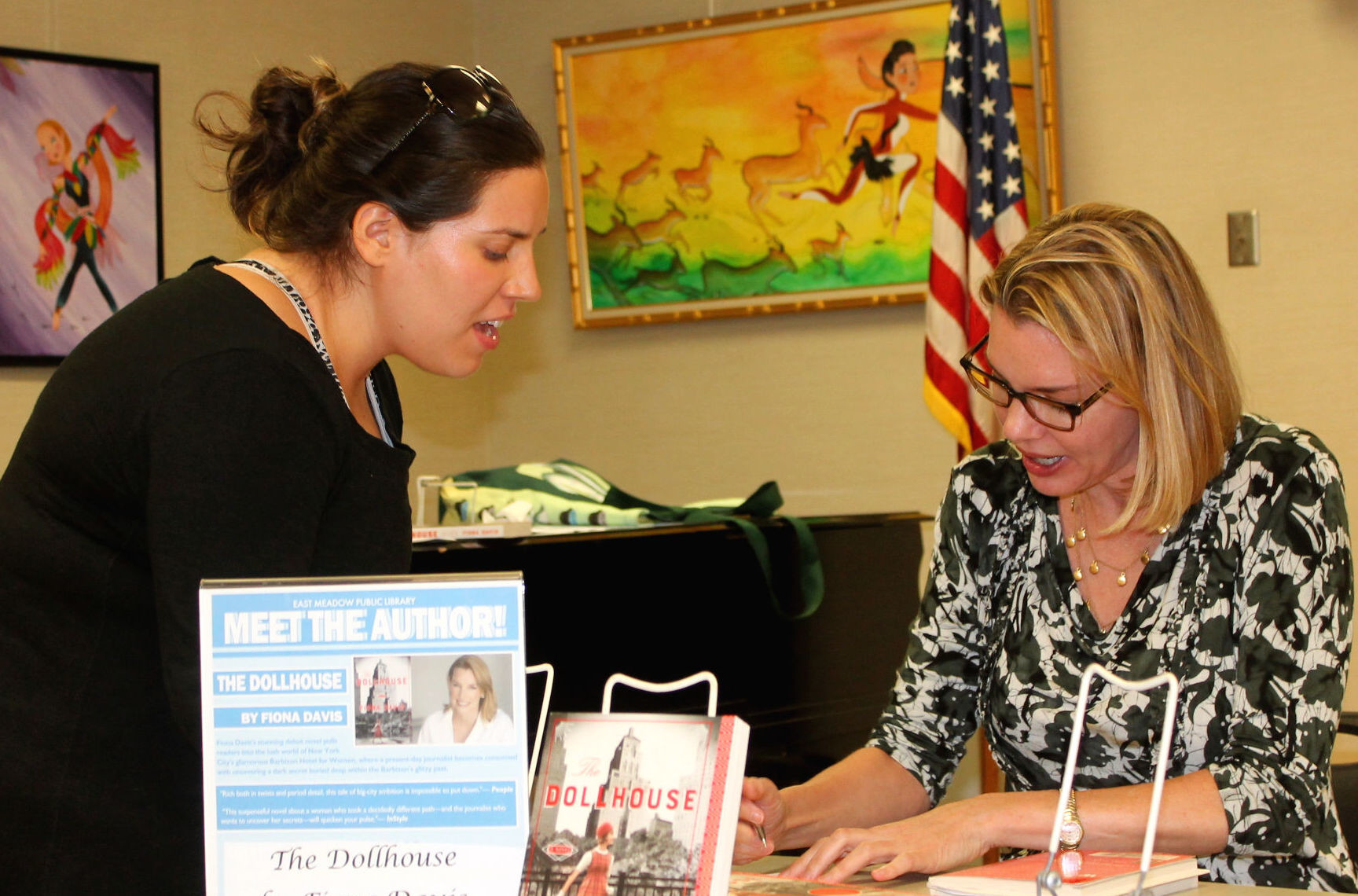 Author Fiona Davis signed books for the audience during a special meet-the-author event on July 18.