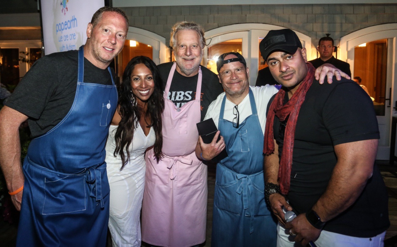 Pop.Earth's Southampton fundraiser raised more than $250,000 for the Eisenhower Park location. Above, from left, Franklin Becker, Pop.Earth board chair; Debbie Stone; chef Jonathan Waxman; Michael Loeb, the event's host, and Shu Chowdry, a co-sponsor.