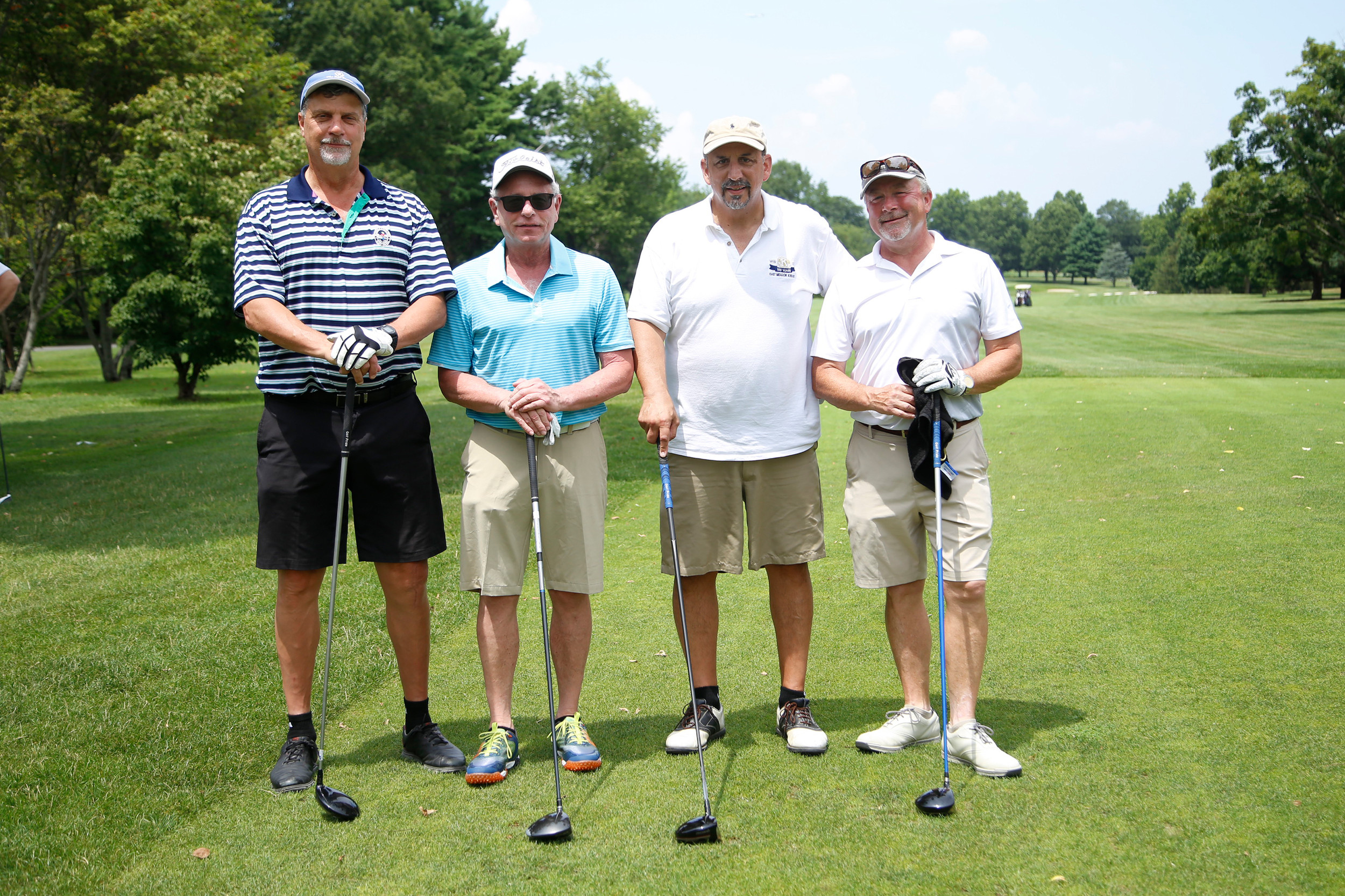 Golfers Peter Mueller, Lane Rubin, fundraiser organizer Alan Beinhacker and Tim King prepped for a long game ahead.