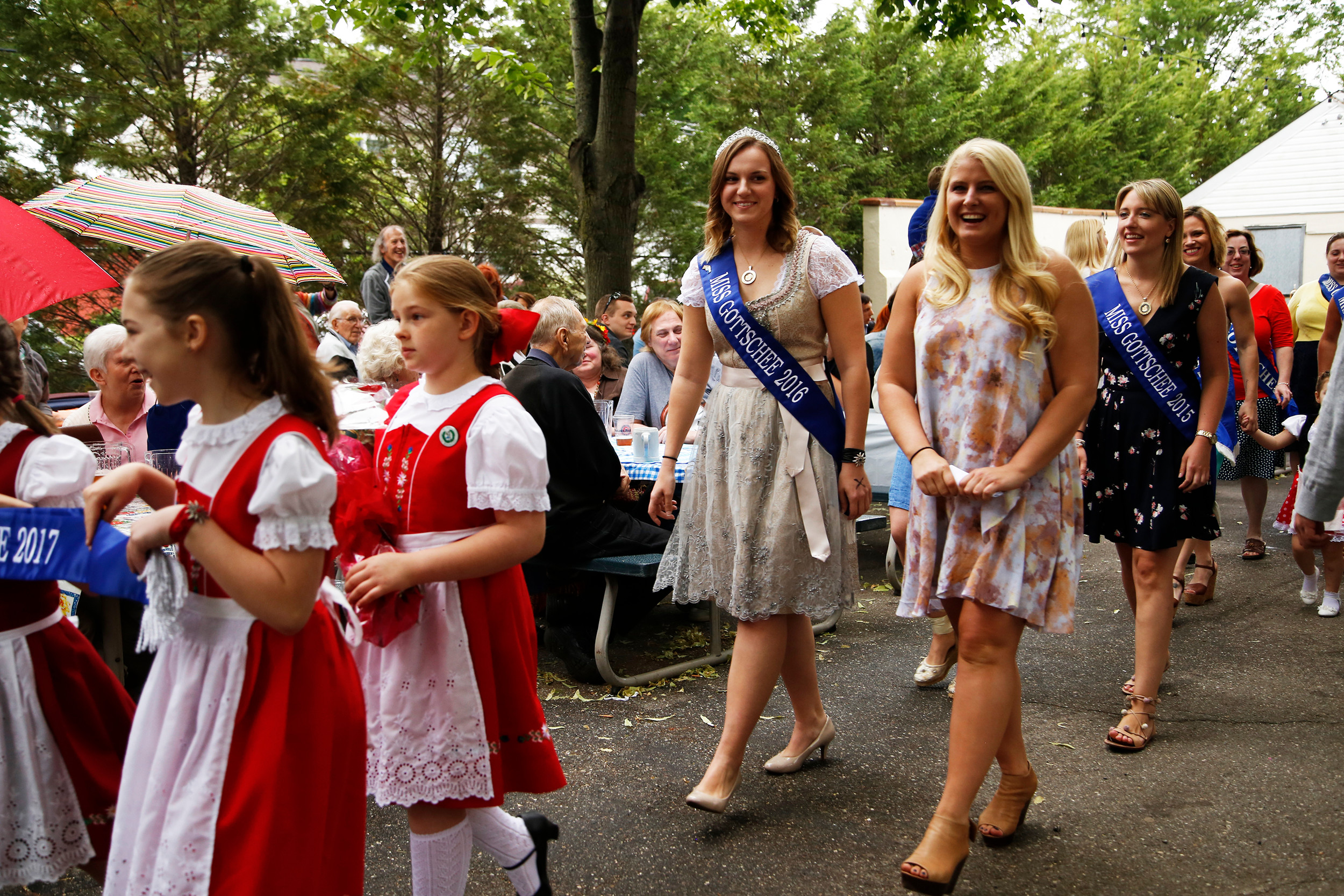 Parade participants marched with smiles during the festivities, including Miss Gottschee 2016 Rebecca Wagner, left, and the new Miss Gottschee 2017, Christina Popowych. They are trailed by past winners of the title.