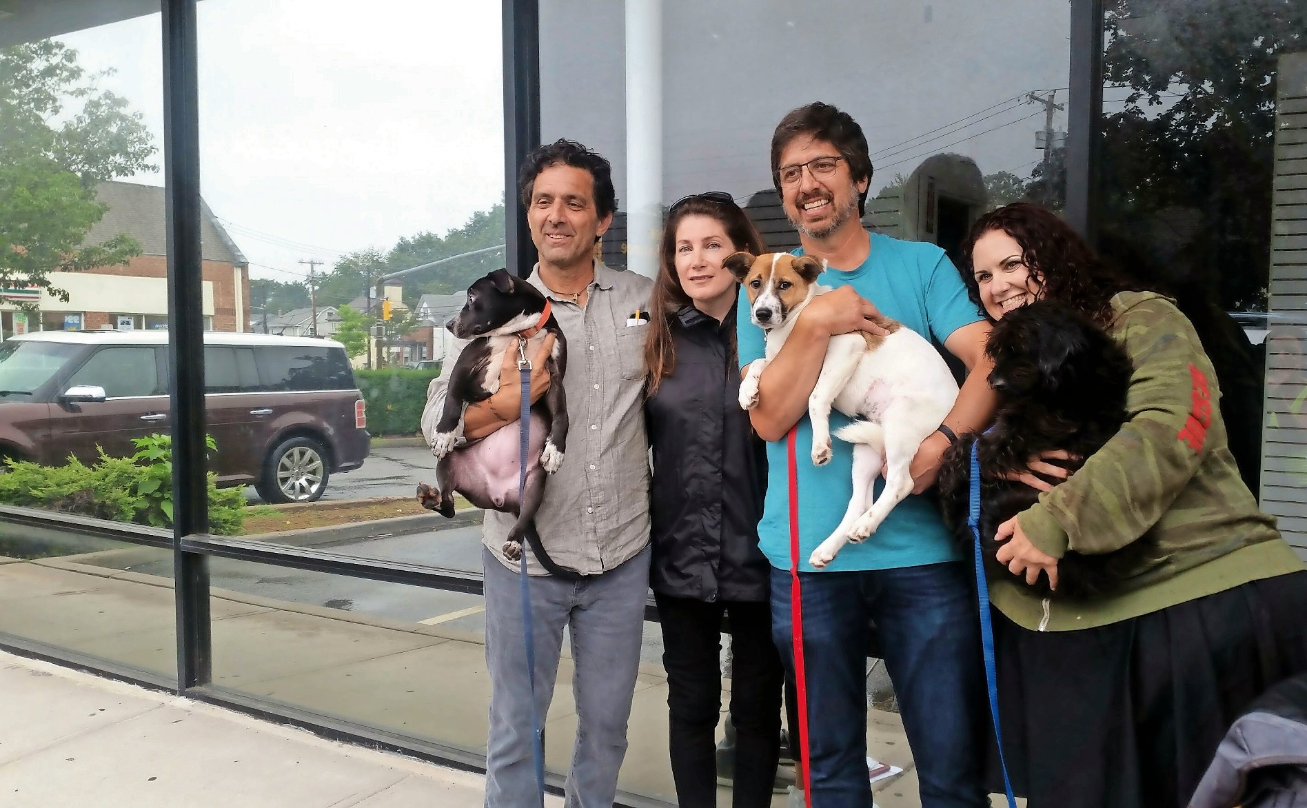 Comedian and television star Ray Romano, visited Glen Cove on Monday with his brother Rich, far left, and Diane Rose and Melissa Savitt, directors at Ruff House Rescue. Rich adopted a dog from Ruff House, which is committed to saving homeless animals.