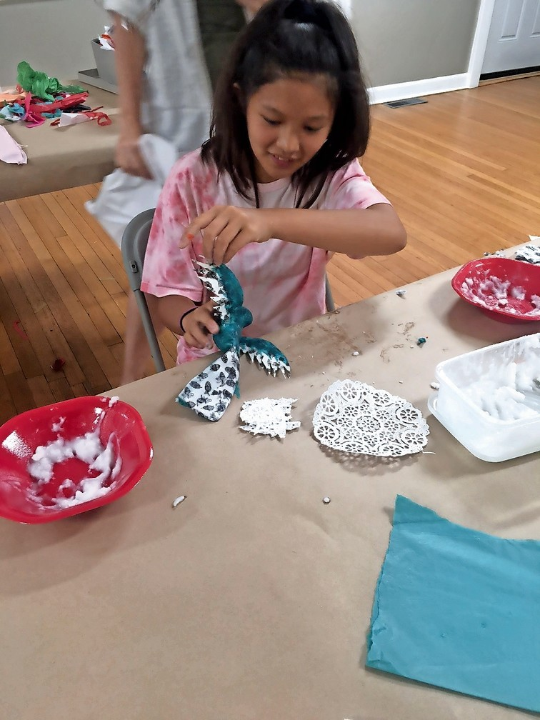 Jenny Geisnar, 12, painting a bird she created in the art workshop at the Glenwood Life Center.