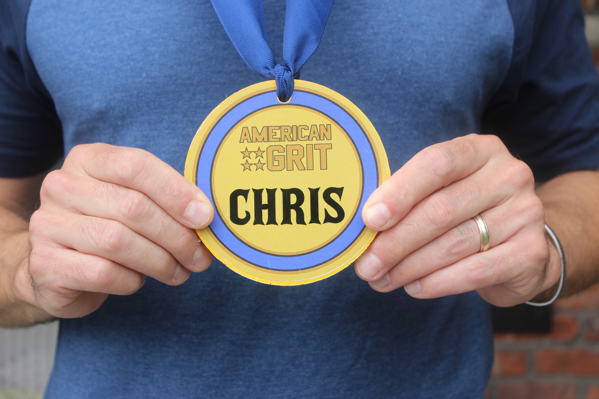 "Contestants on the reality show, ""American Grit,"" wore medals like the one depicted in numerous military-themed challenges."